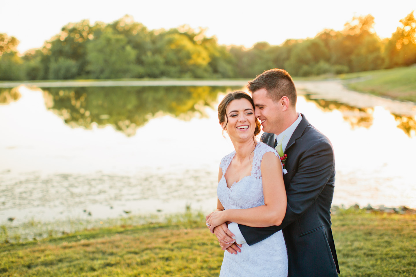 bride and groom laughing in sunset photo