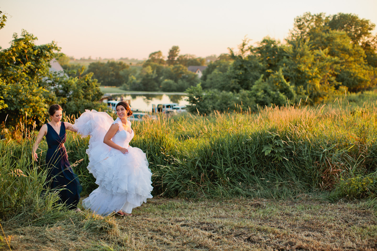 bride and groom in field of flowers at sunset des moines wedding photographers
