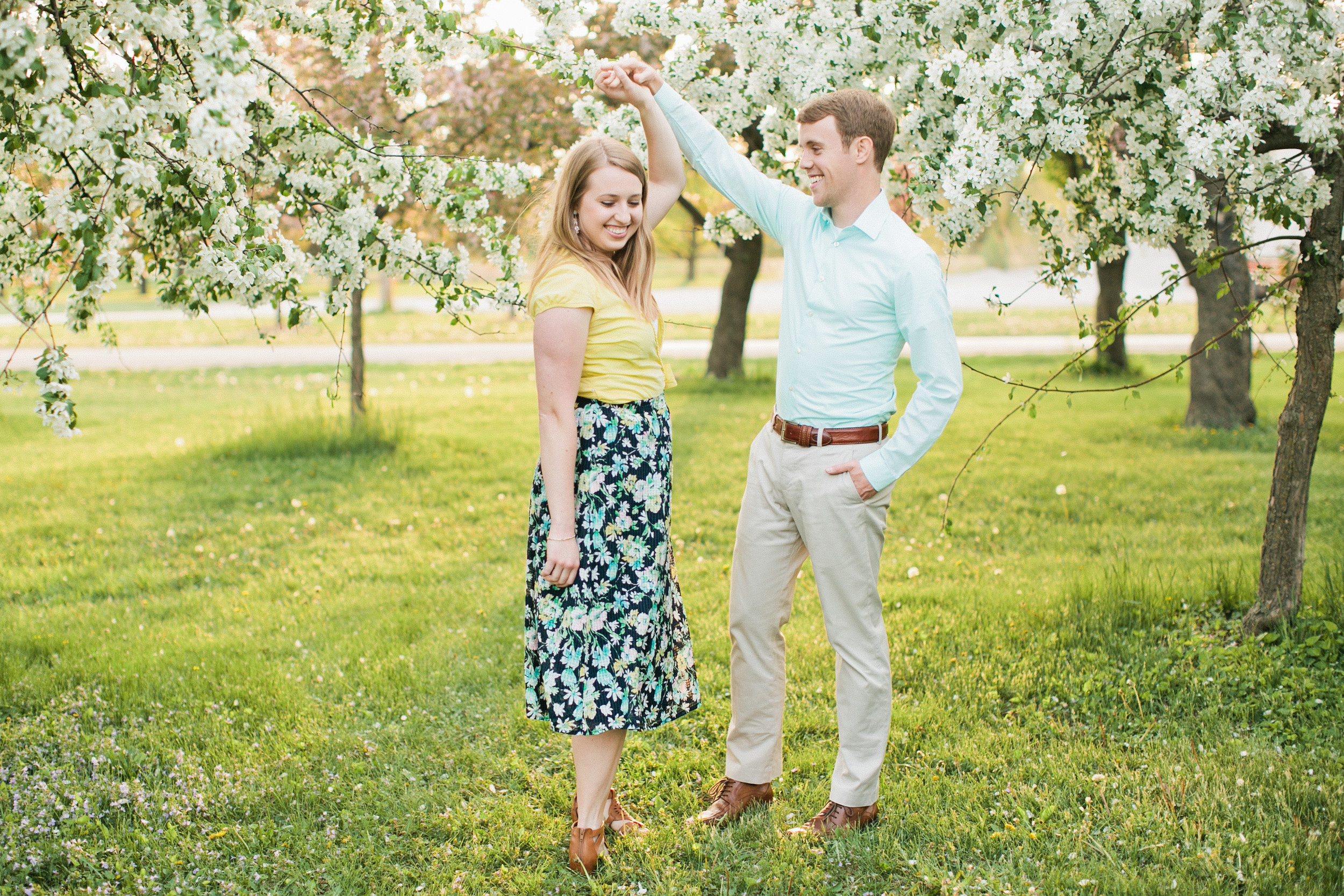 couple dancing in flower trees des moines iowa engaged