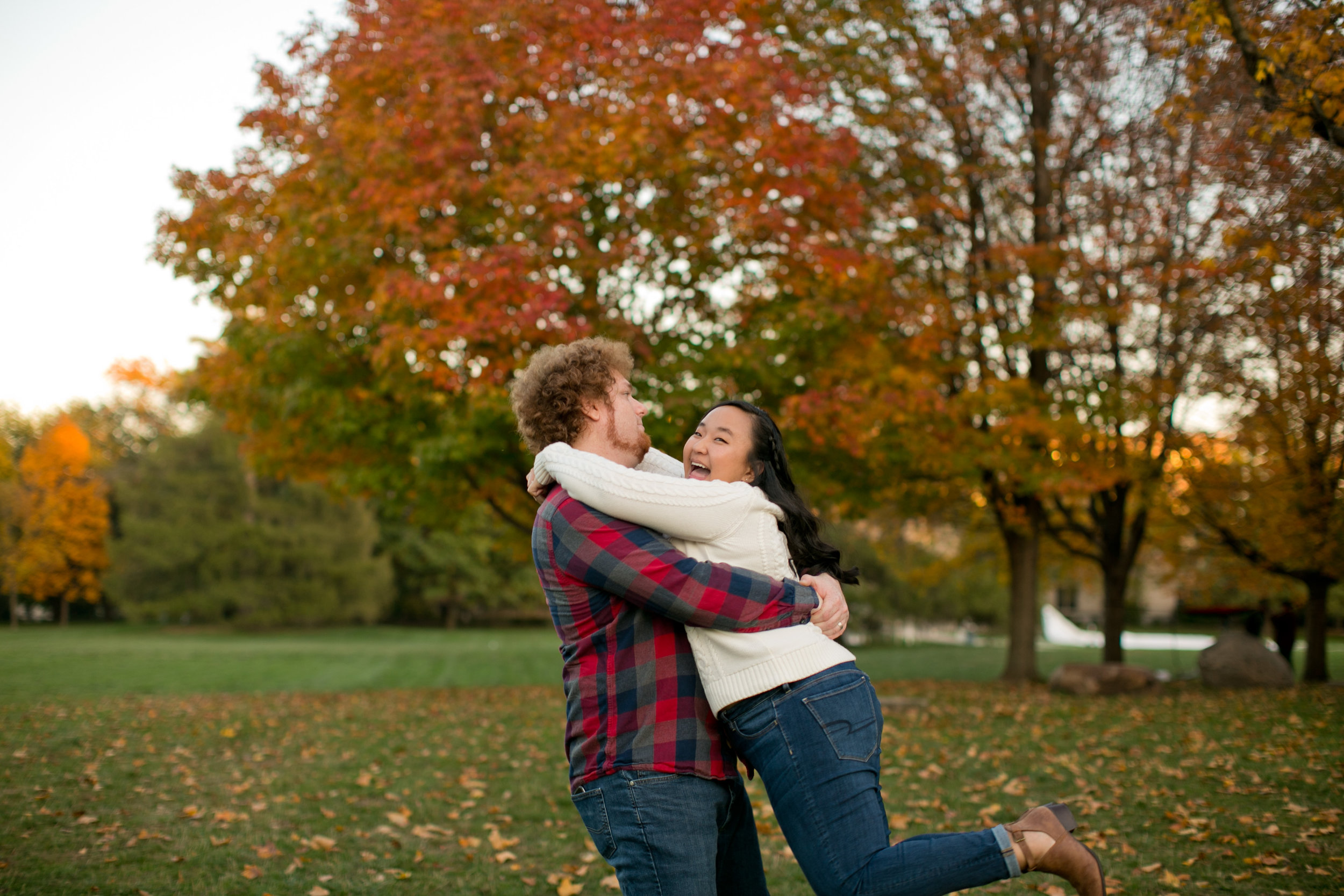 couple posing ideas for tall guy and short girl engagement pictures