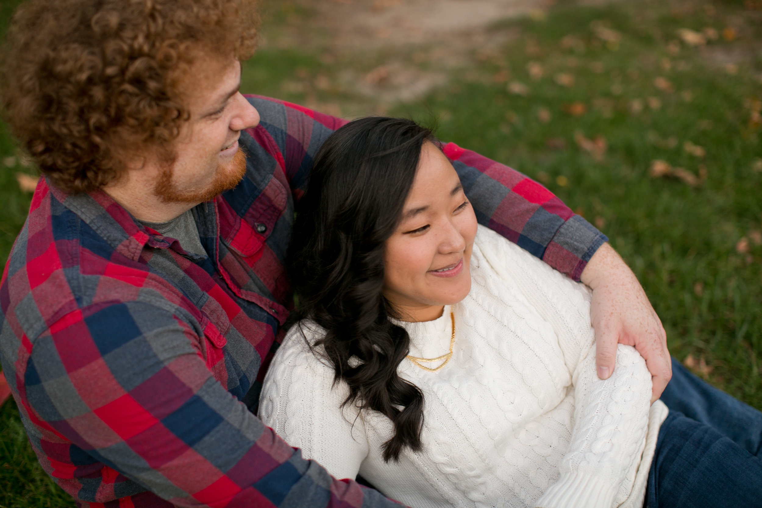 man with curly red hair and asian girl engagement photos