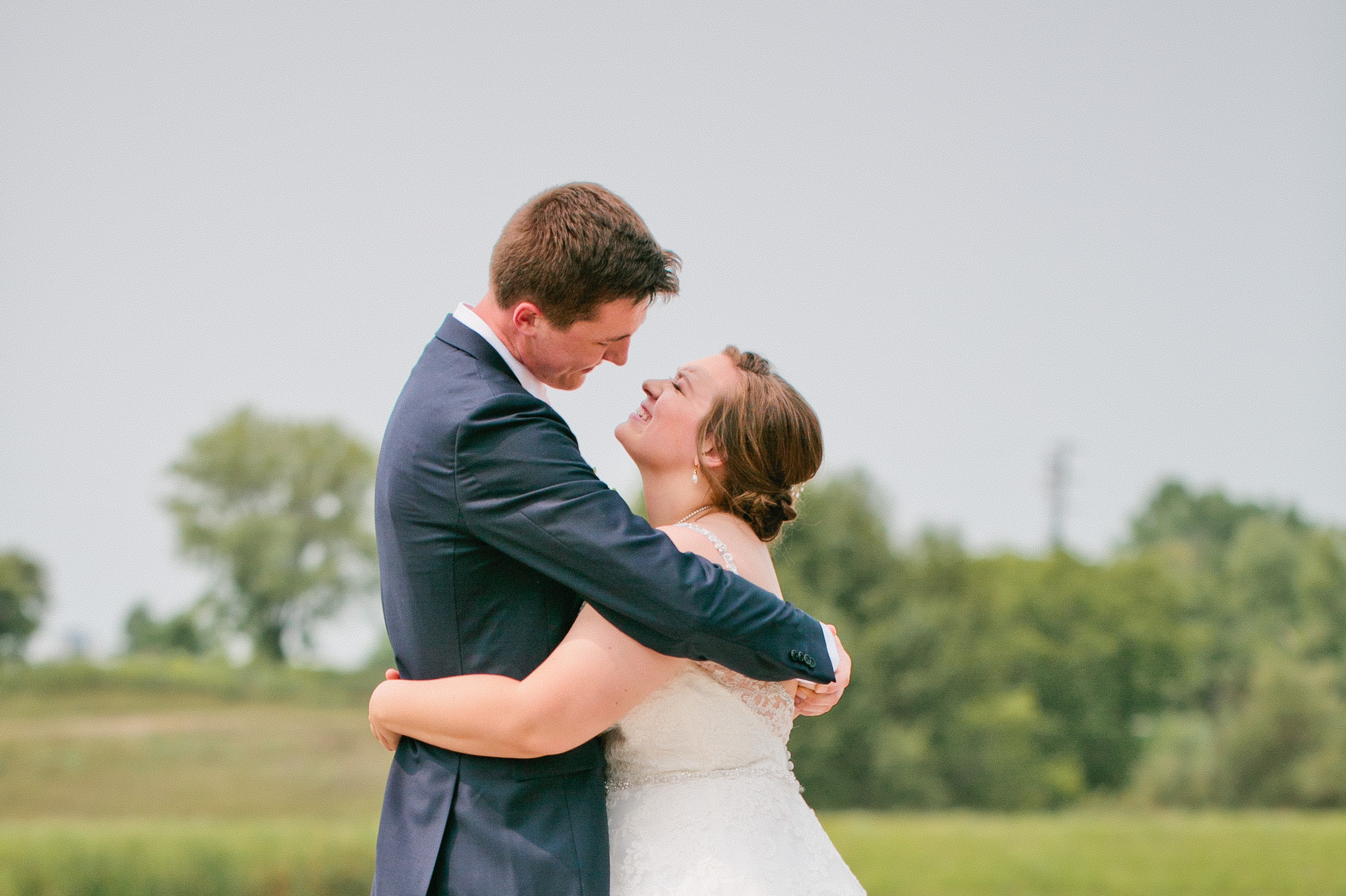overcast wedding day outdoor wedding by lake in Clear Lake wedding photography