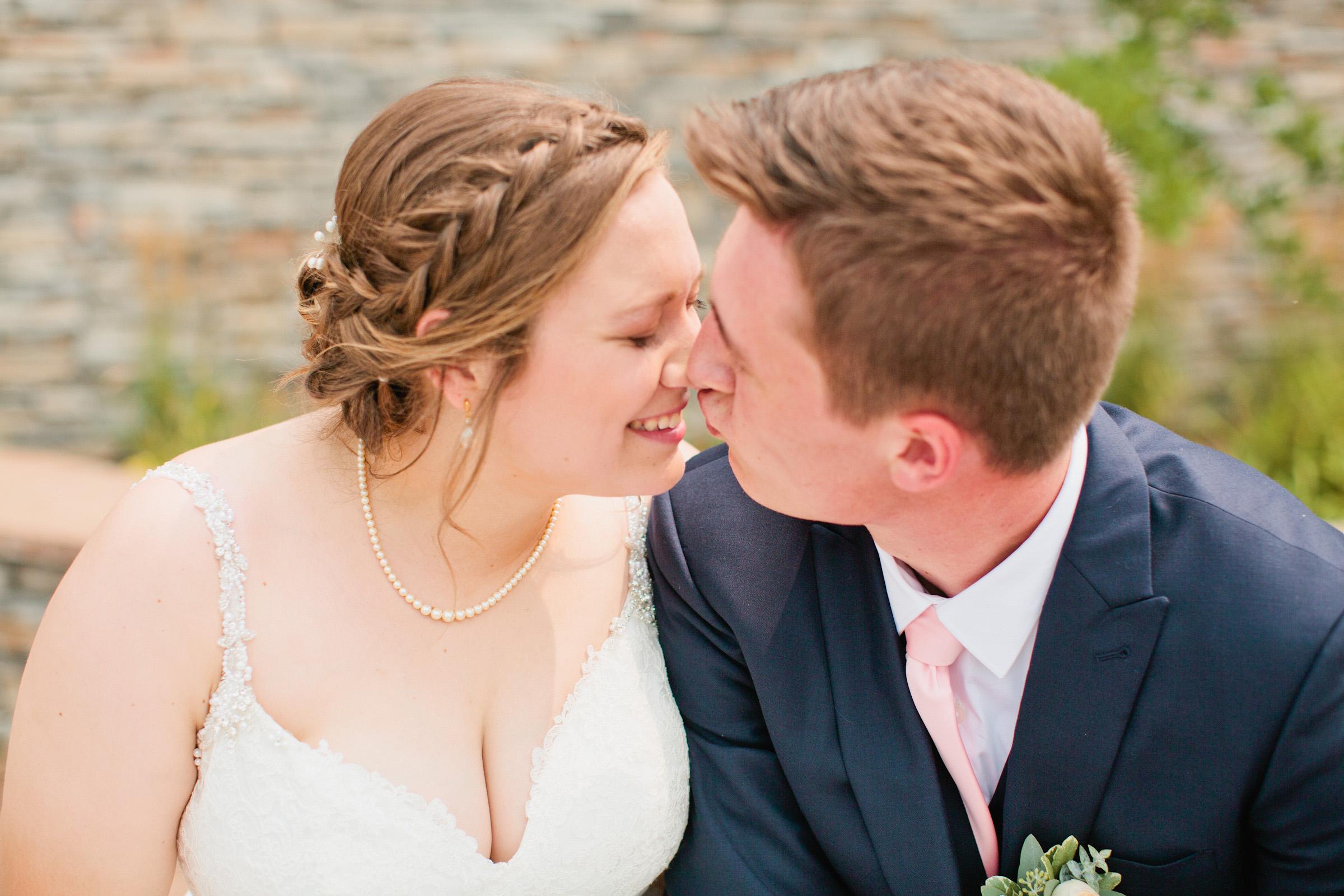 groom kissing bride on tip of nose