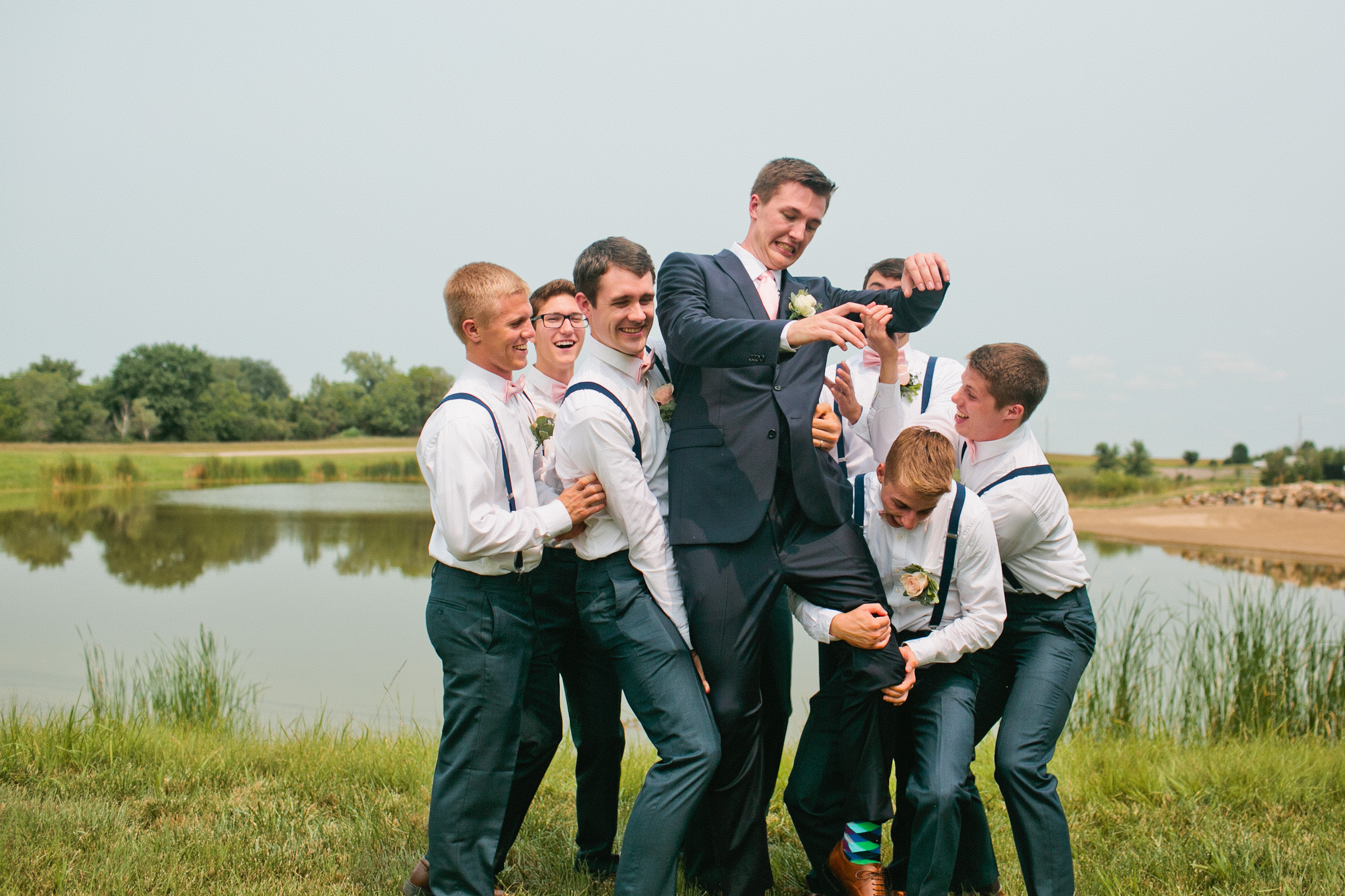 groom-getting-picked-up-by-friends