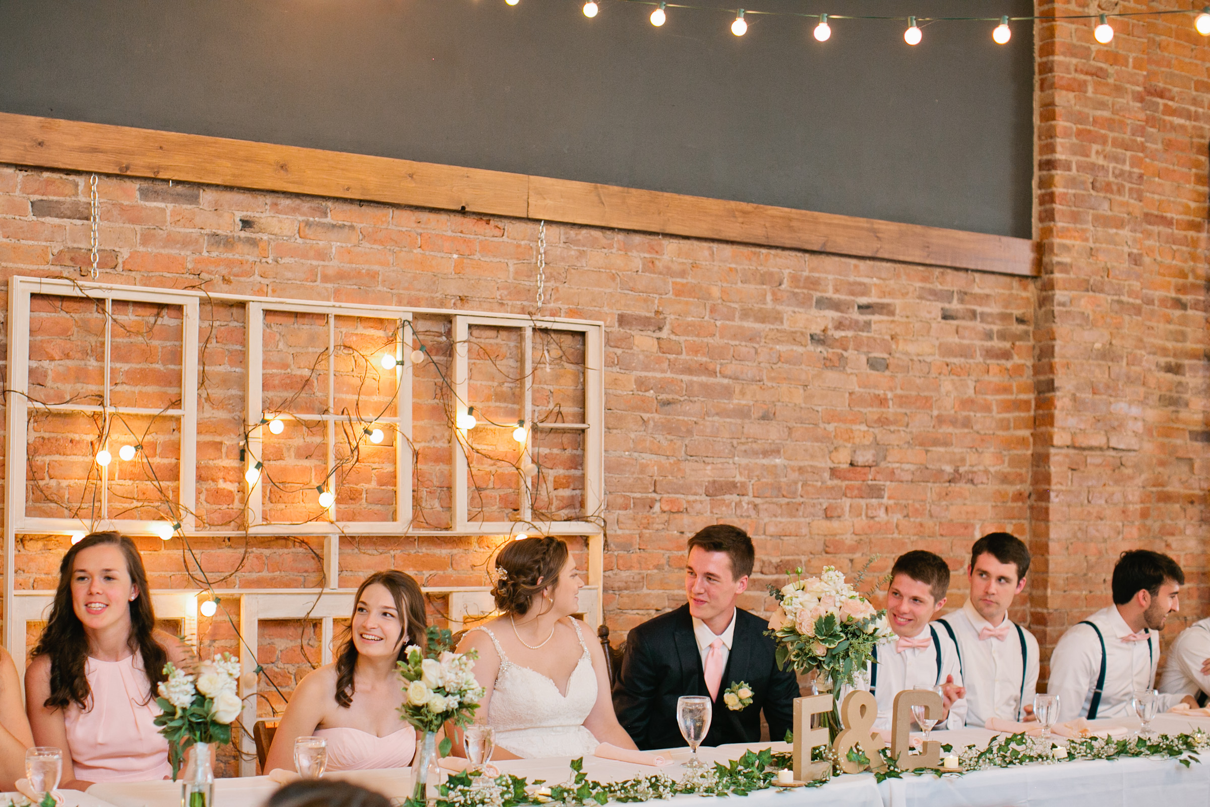 head table with flowers and twinkle lights gatherings nevada iowa