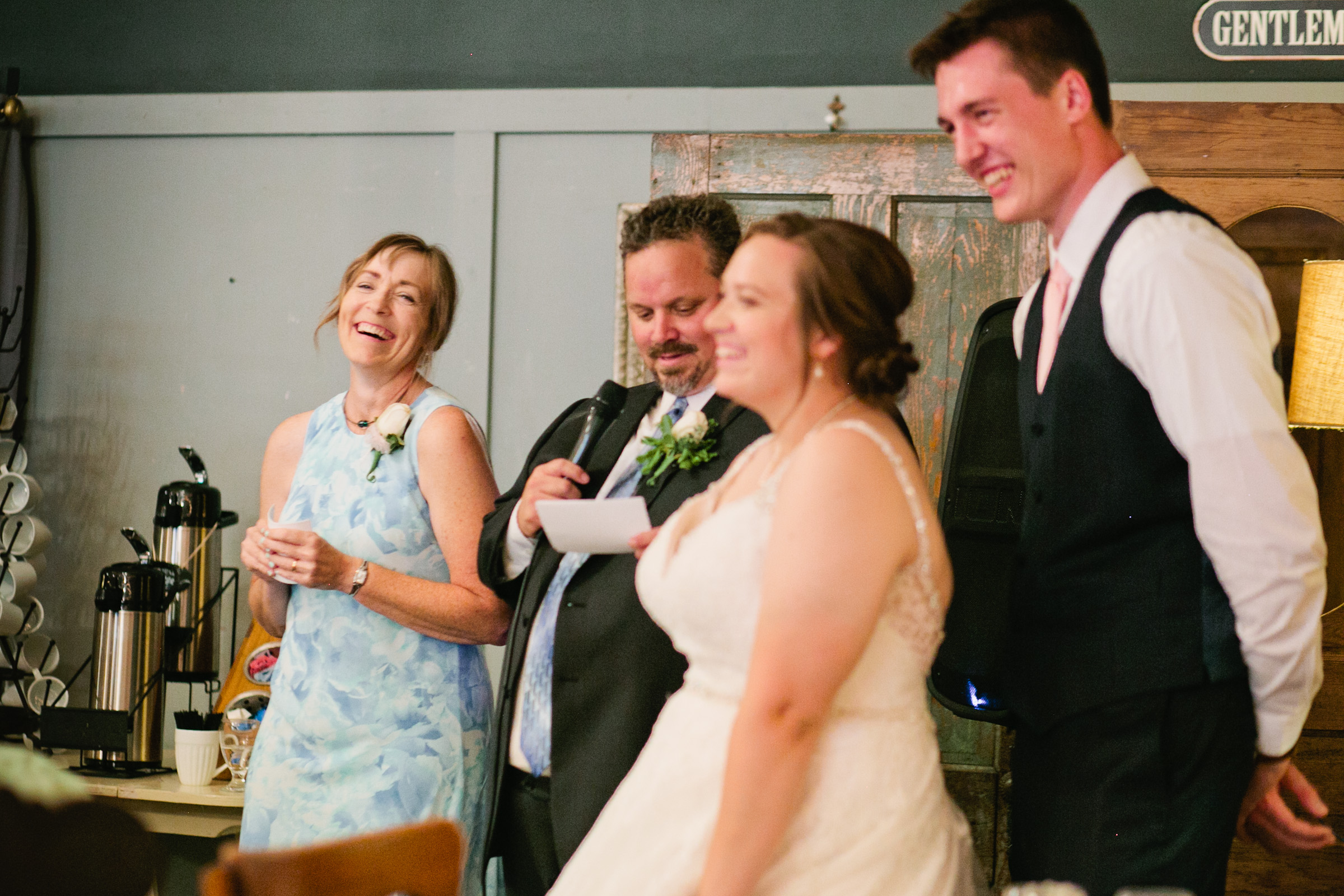 parents of bride laughing at toast Des Moines wedding