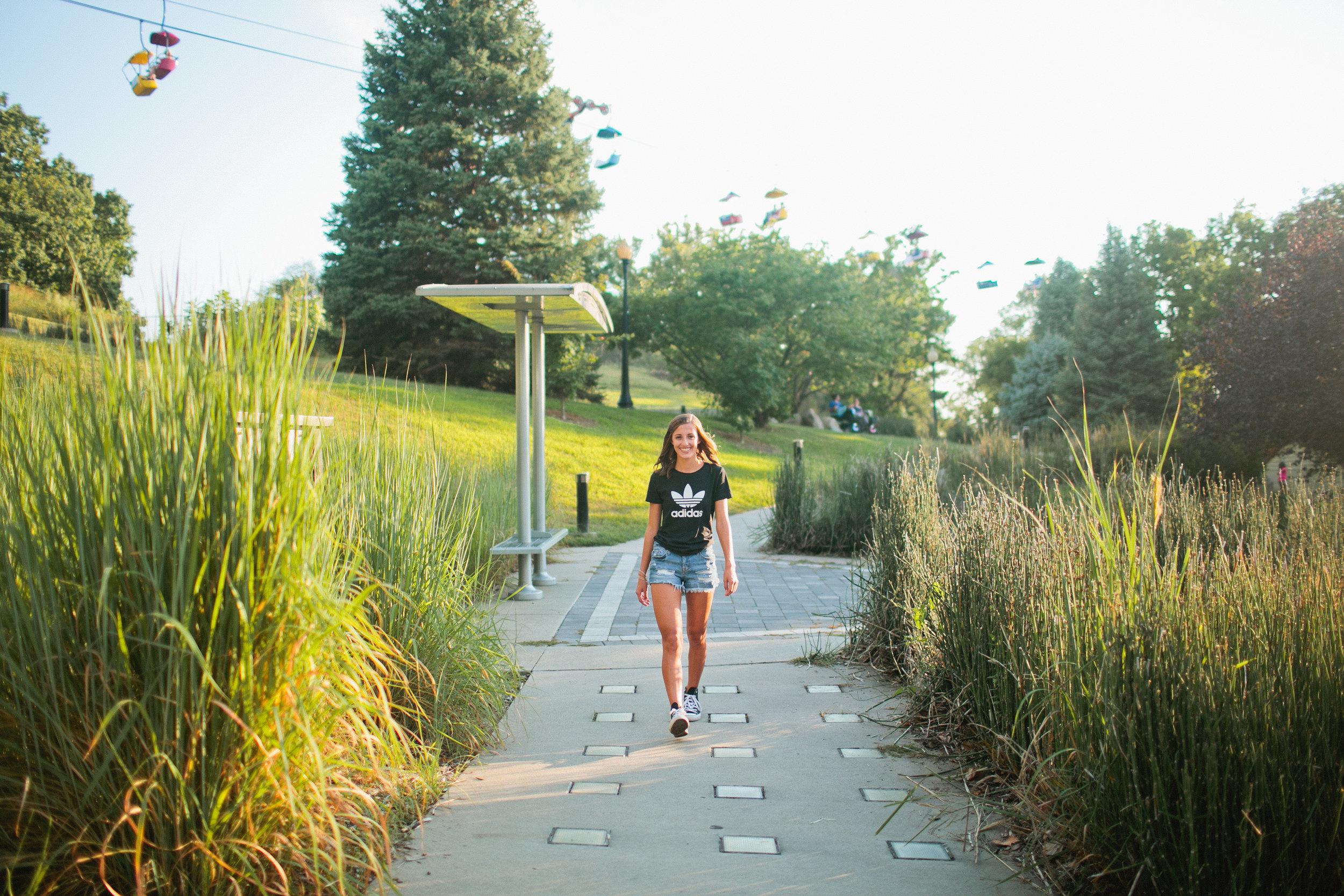 senior girl walking under sky glider at Iowa State Fair