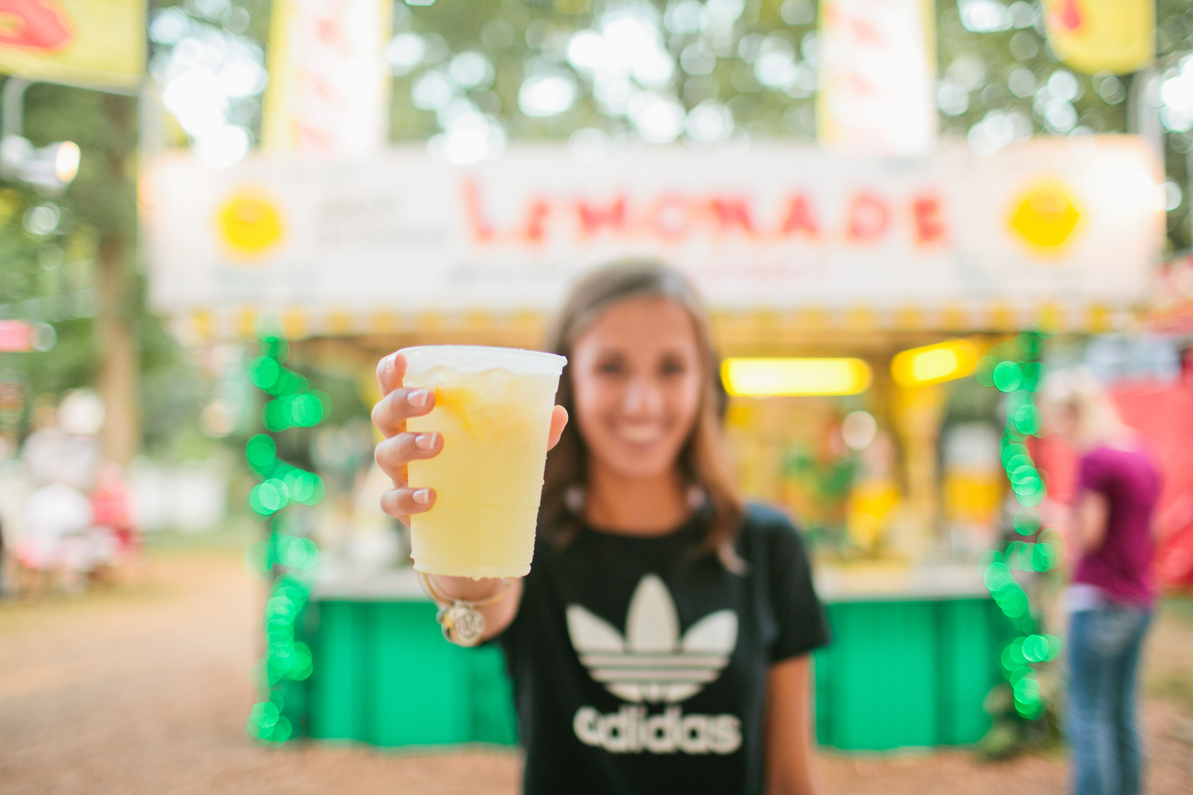 senior girl holding lemonade at Iowa State Fair