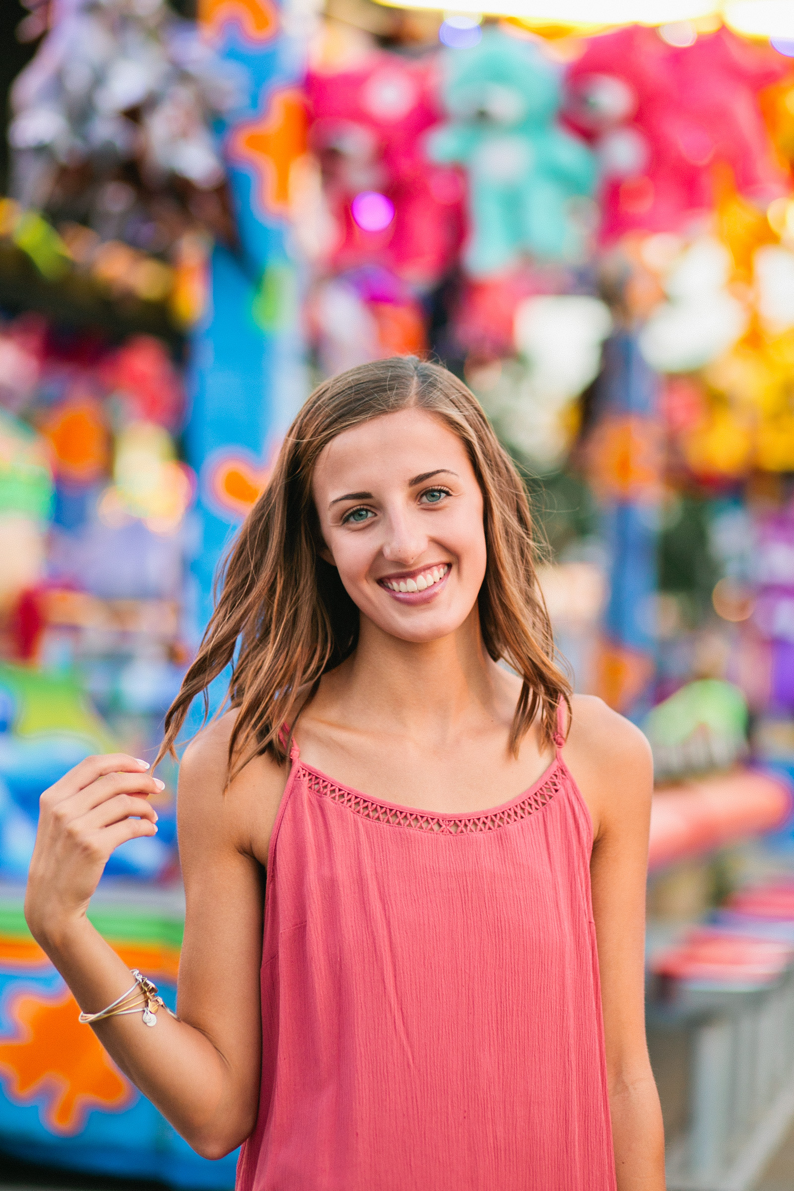 amelia-renee-photography-iowa-state-fair-senior-photos-10.jpg girl in pink dress at iowa state fair
