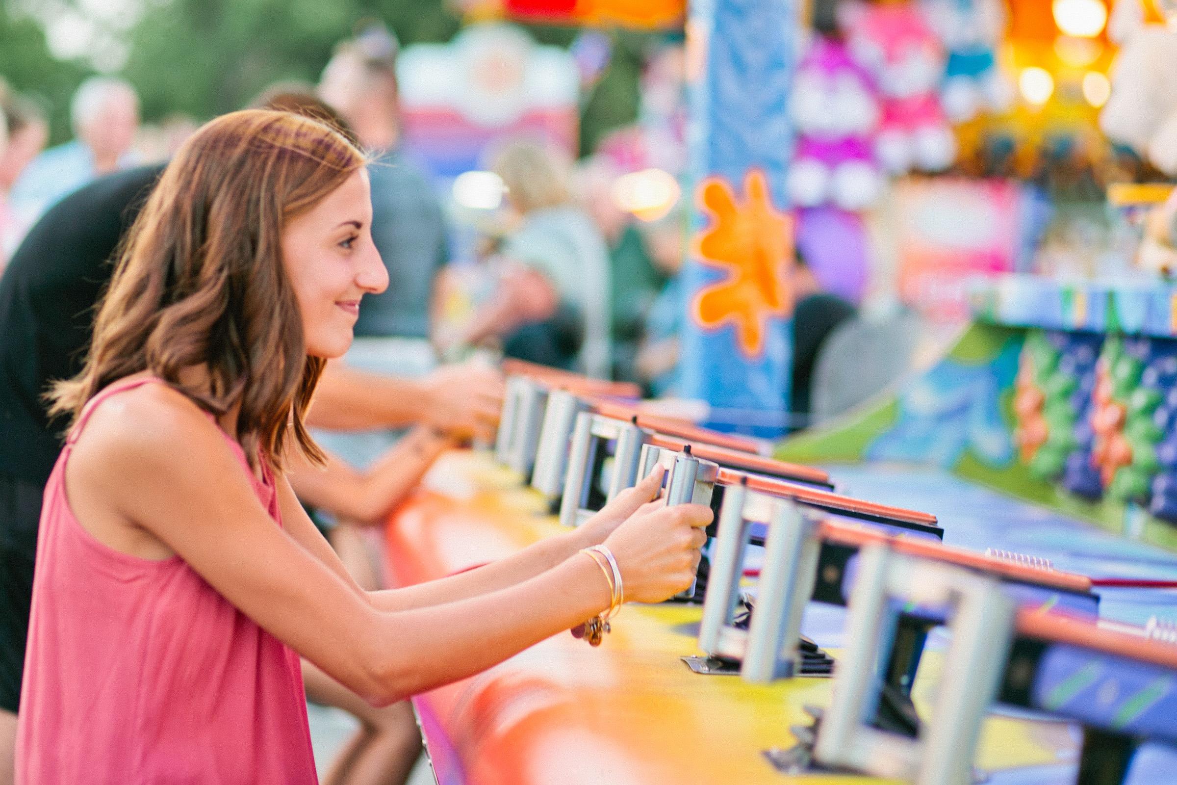 senior playing arcade games at the state fair