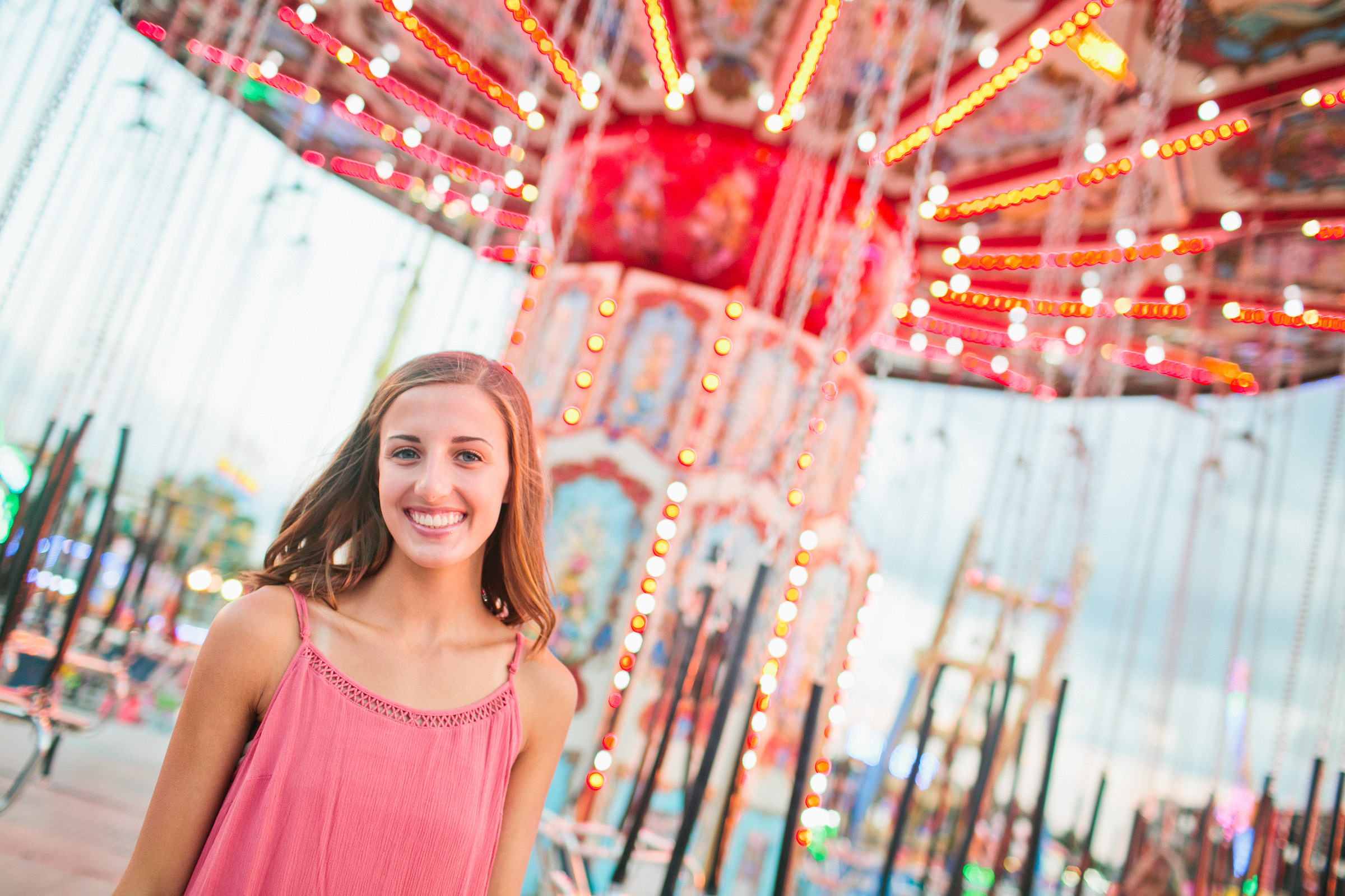 swing ride at iowa state fair senior in pink dress cute girl Midway