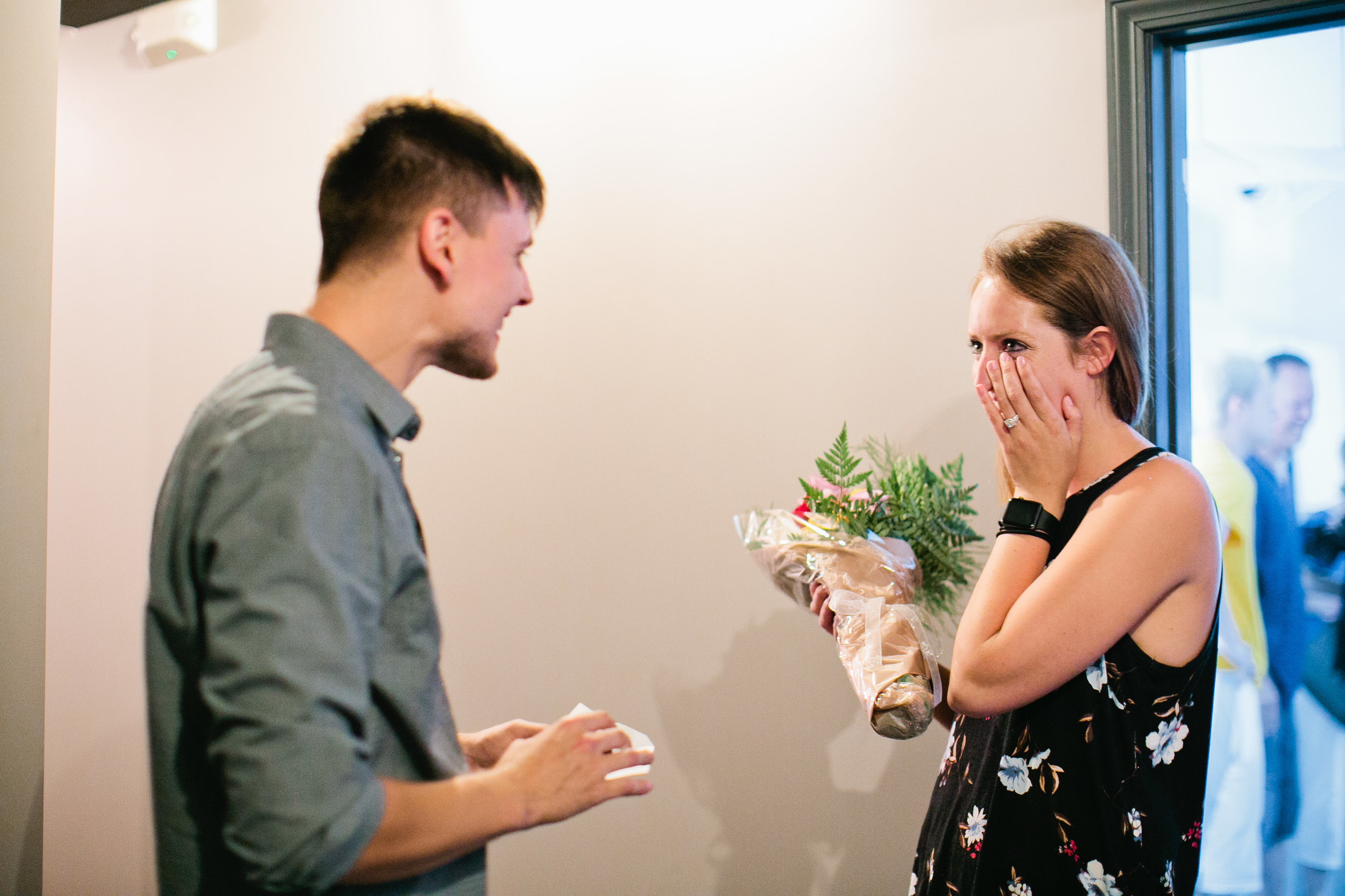 fiance proposal with flowers and puzzle