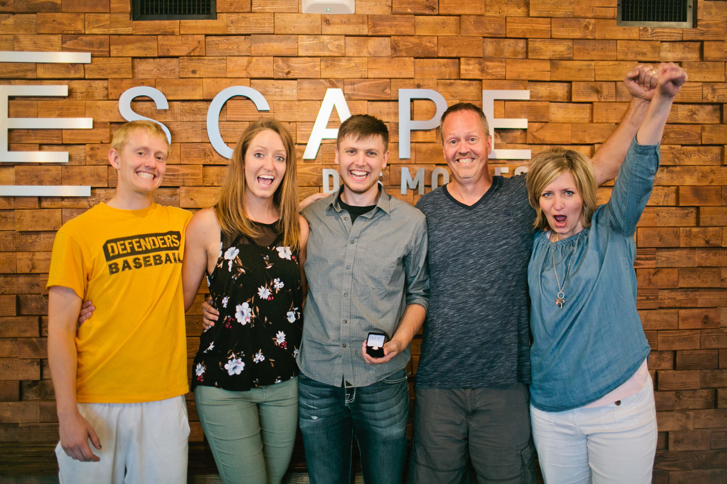 family celebrating after proposal in west des moines