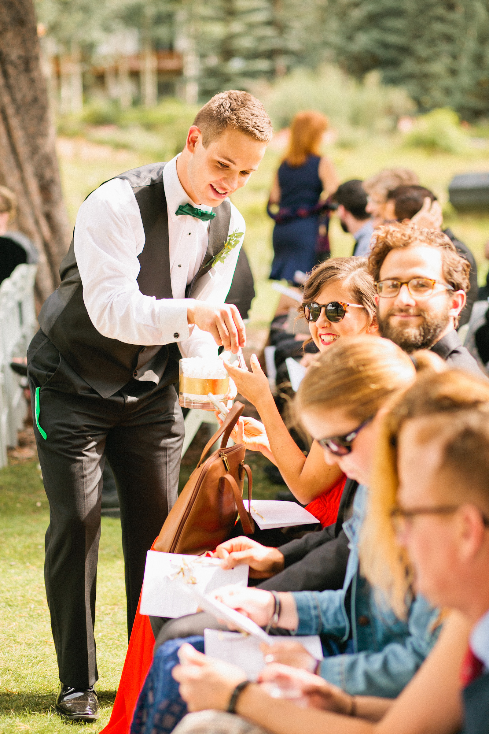 usher handing out bubbles at outdoor Vail mountain wedding