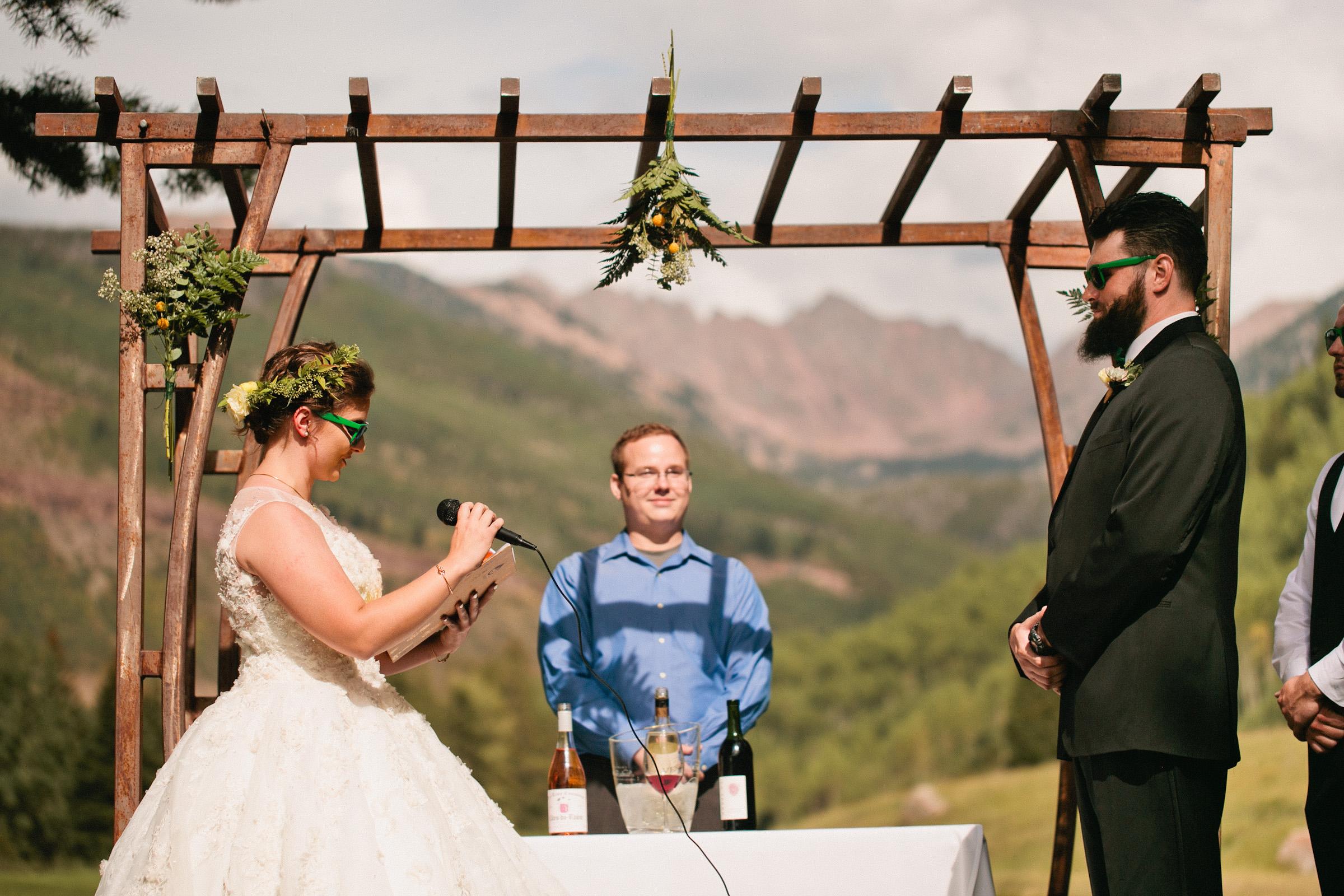 bride and groom saying vows outdoor Colorado Mountain wedding ceremony