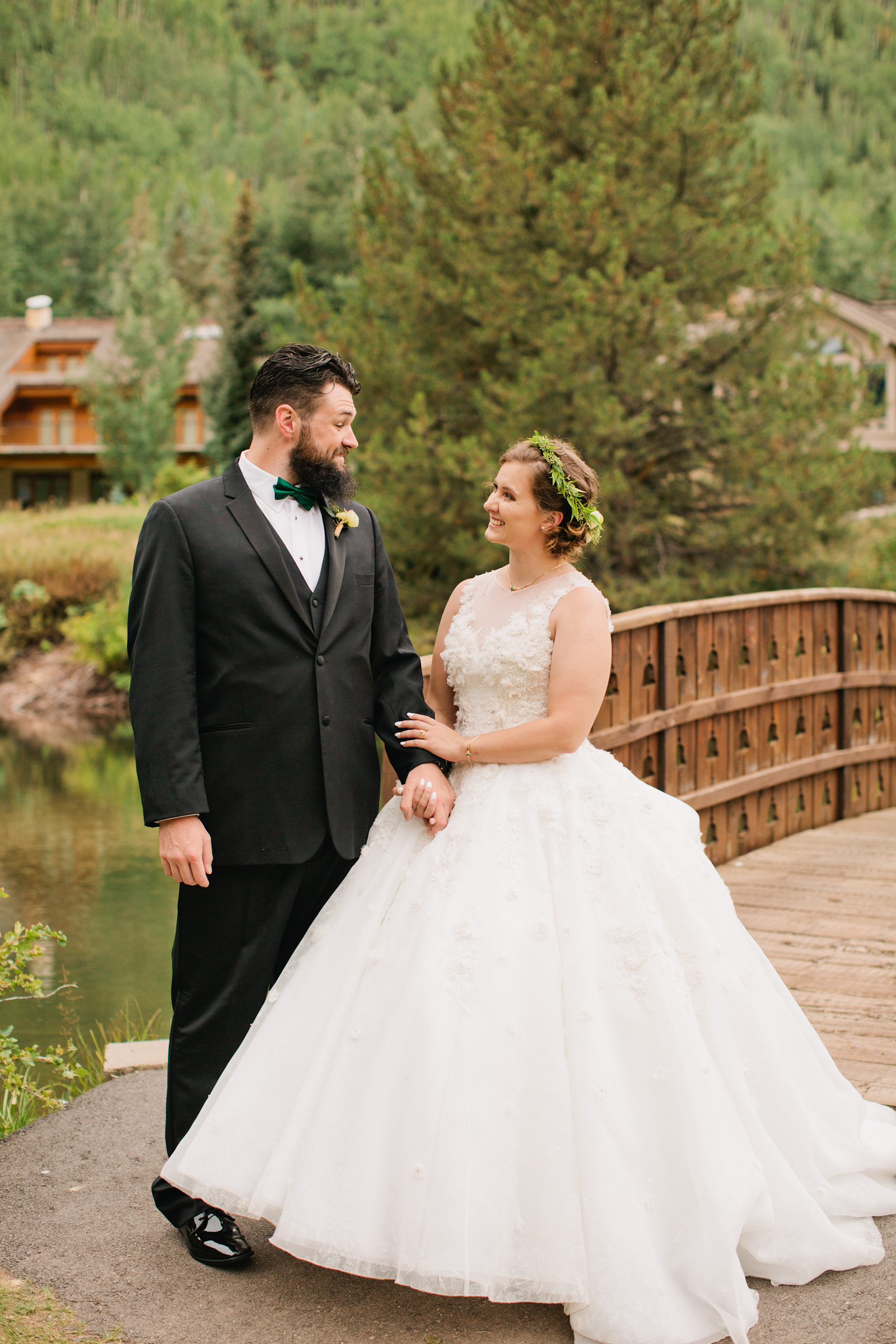 romantic wedding pictures at the base of a mountain lake in Vail, Colorado