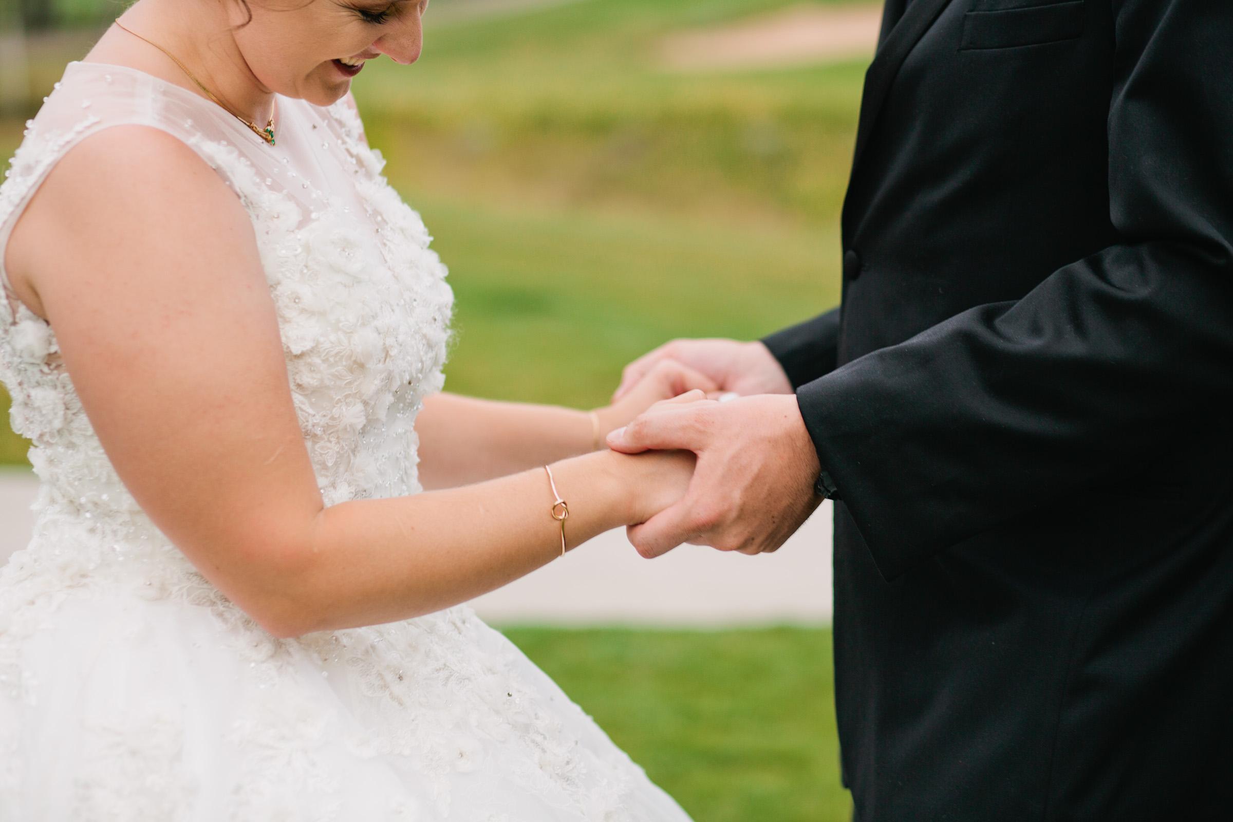 bride wearing golden knot bracelet