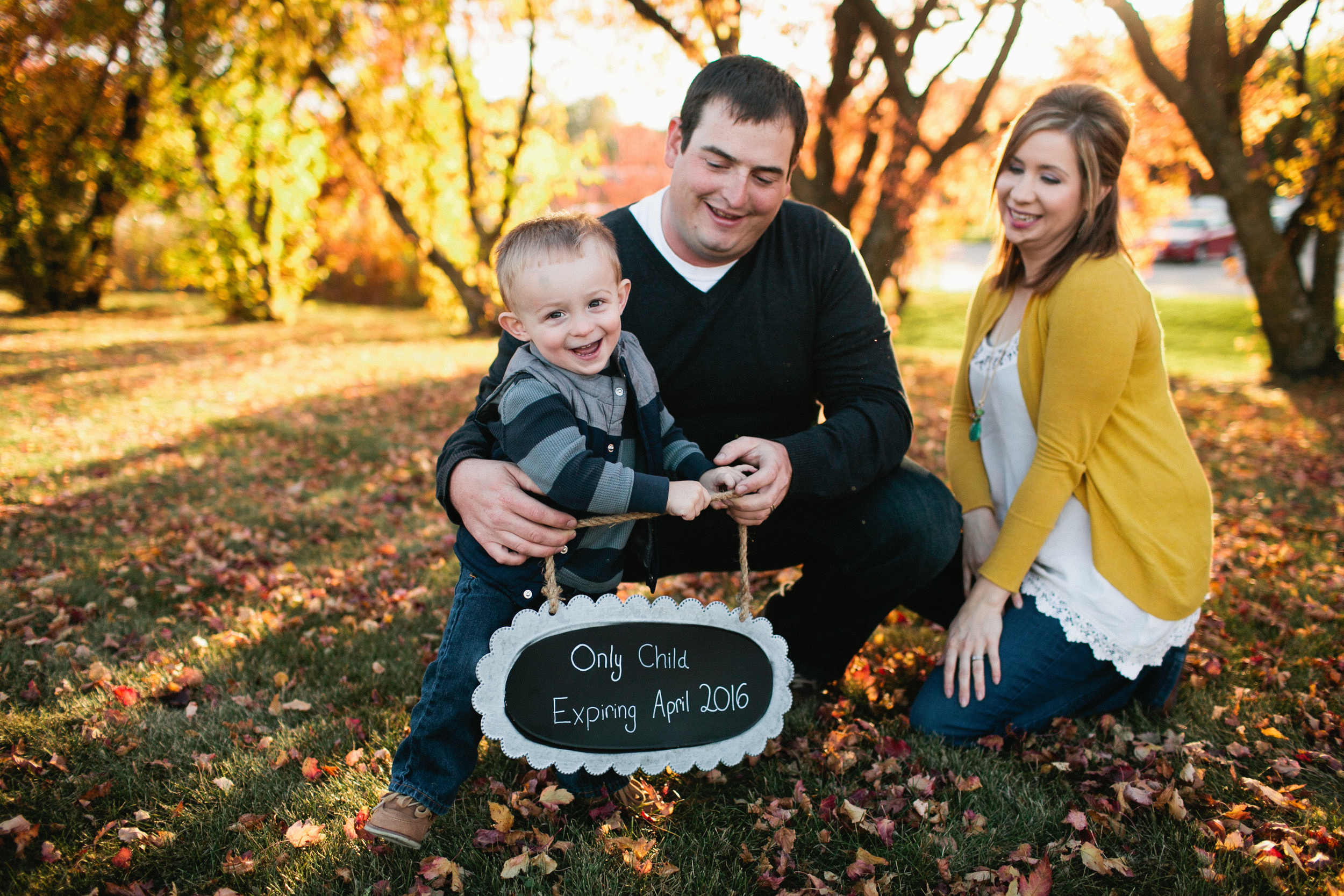 pregnancy announcement photos in Ankeny Des Moines in fall family pictures