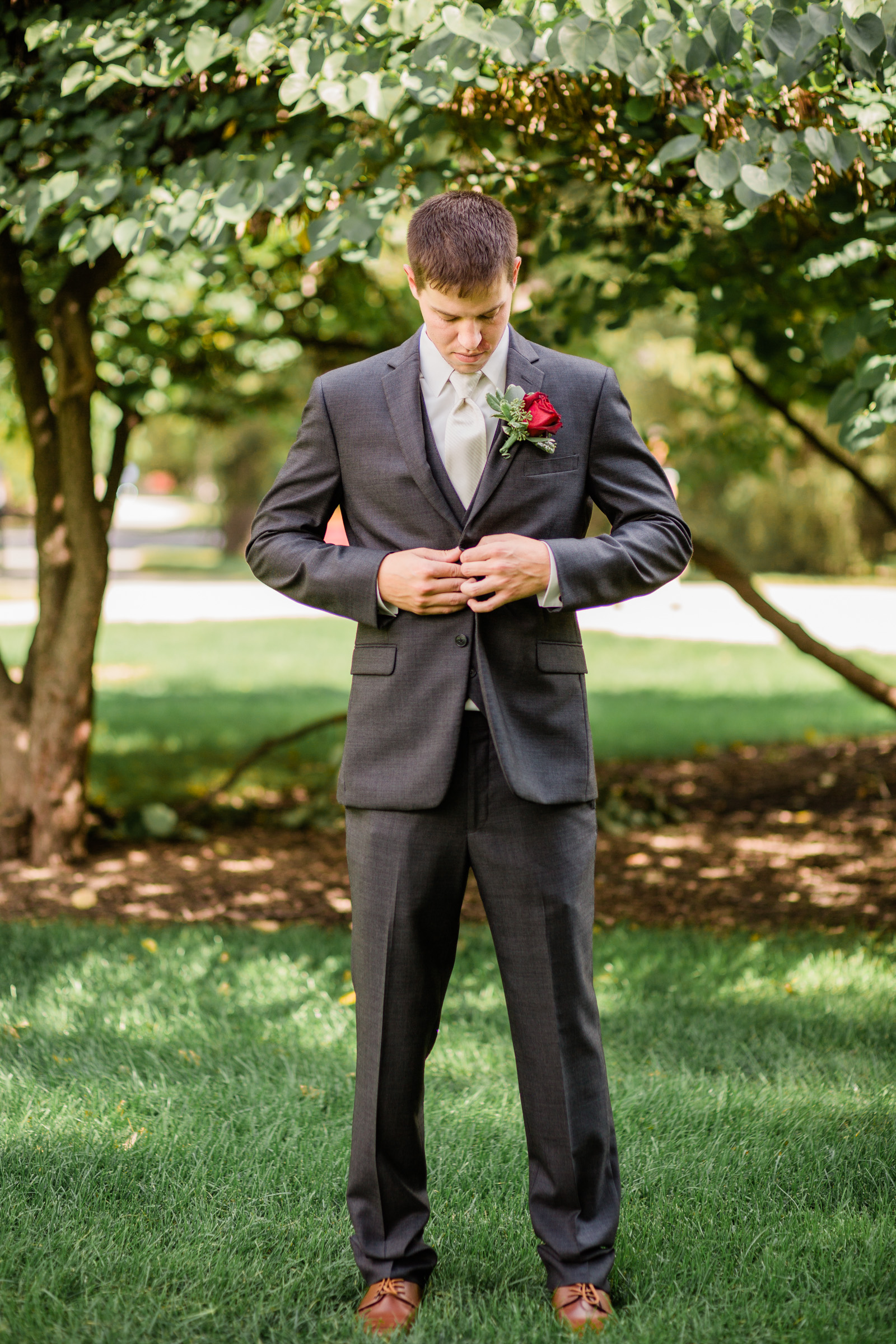 groom getting ready on central campus iowa state university wedding