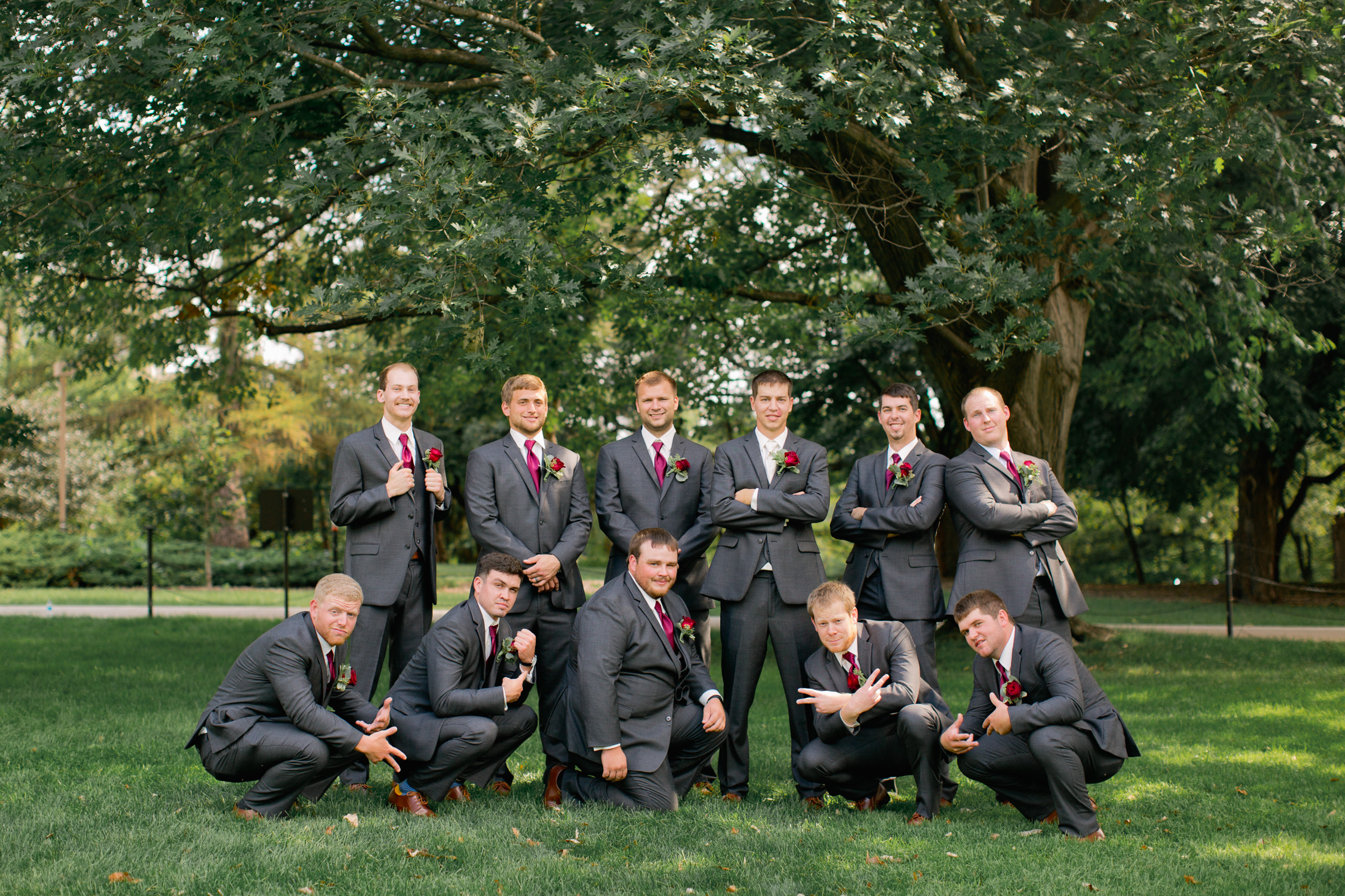 Iowa State university in Ames Iowa groomsmen looking cool and squatting