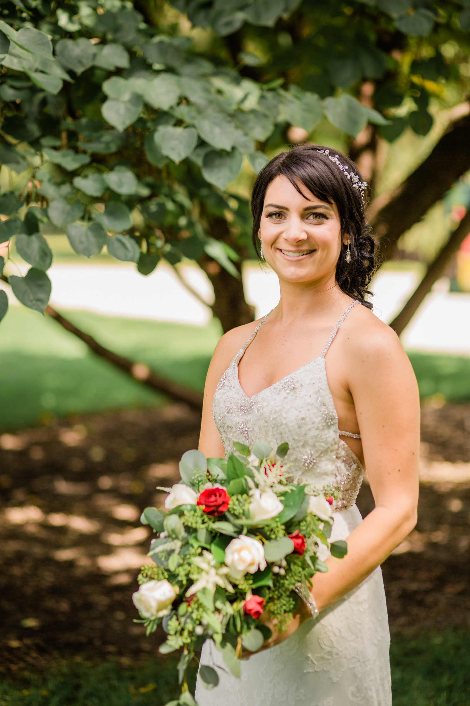bride getting ready outdoors holding flowers Des Moines Iowa