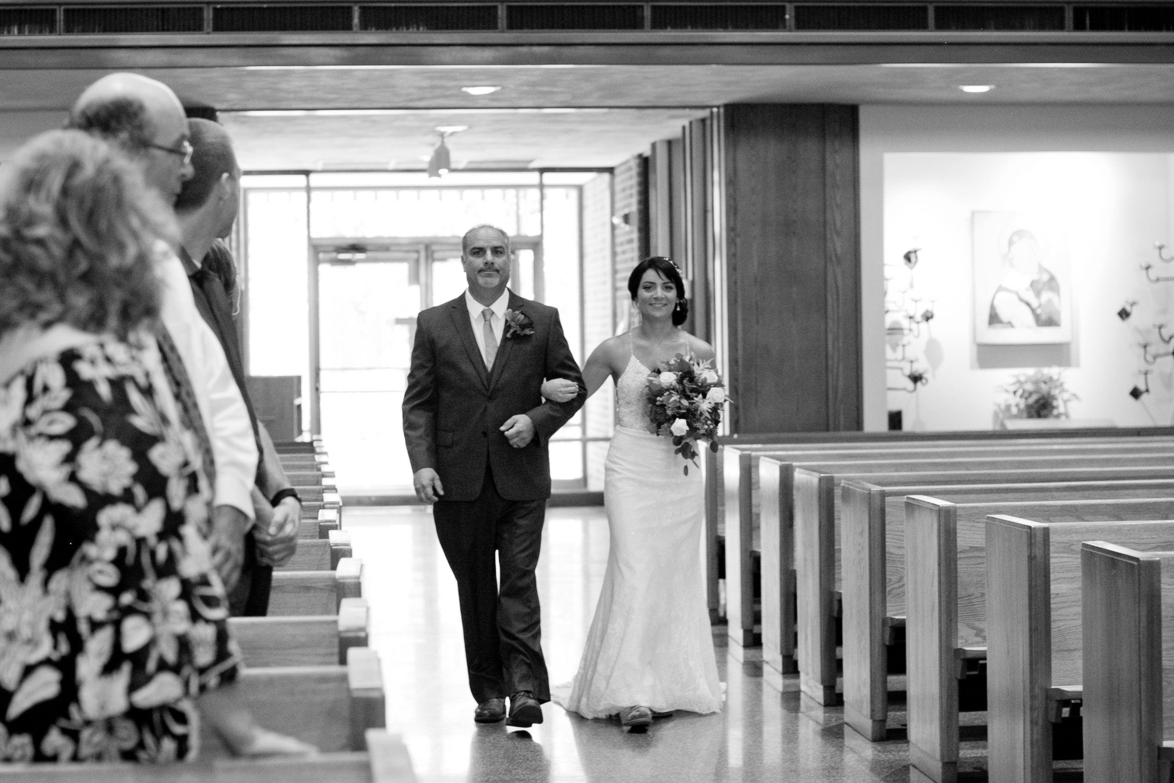 bride and father walking down the aisle together