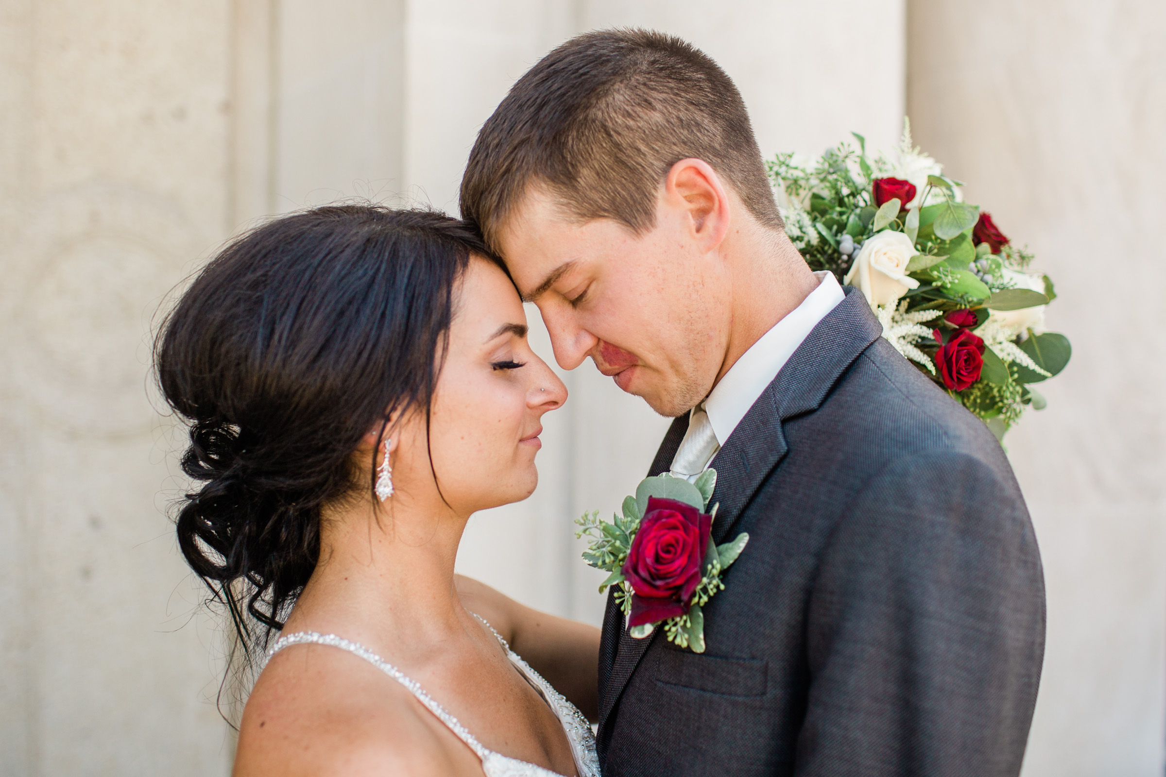 bride and groom closing eyes together on wedding day des moines