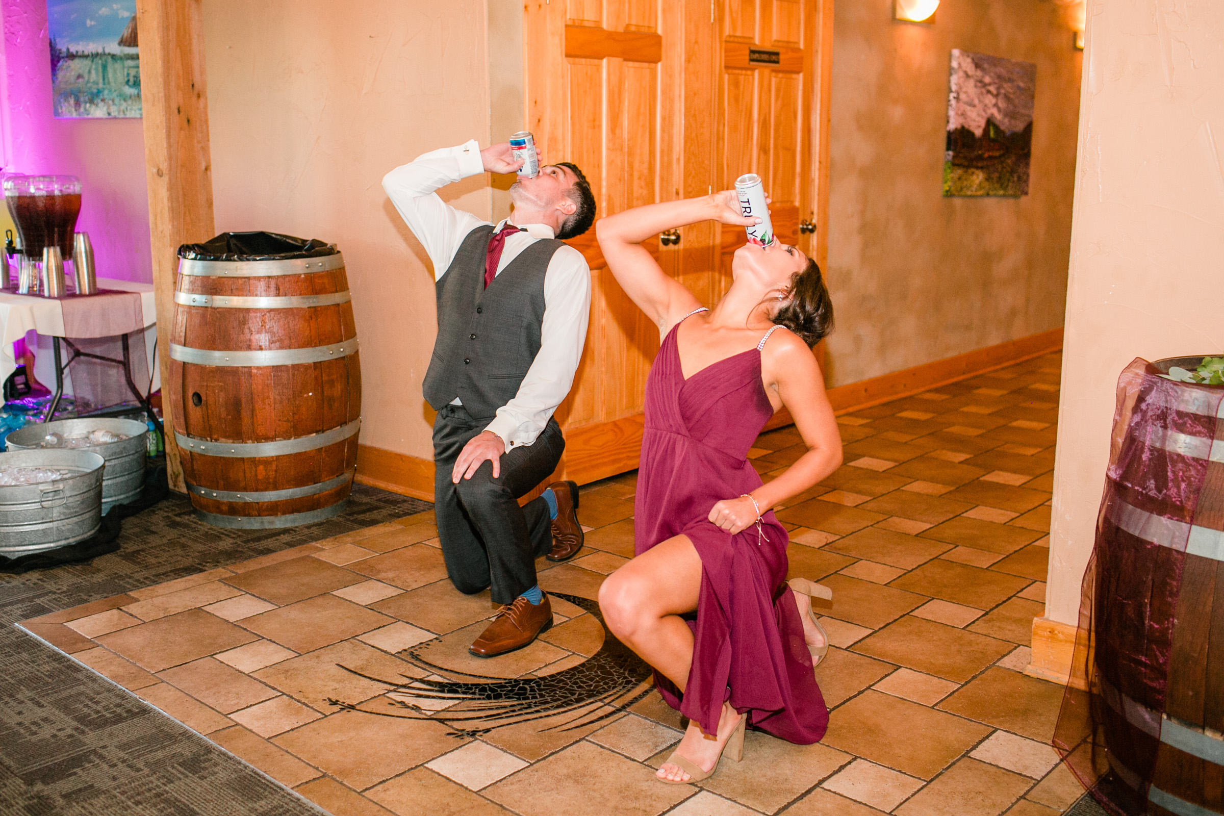 funny wedding moment beer chug while kneeling