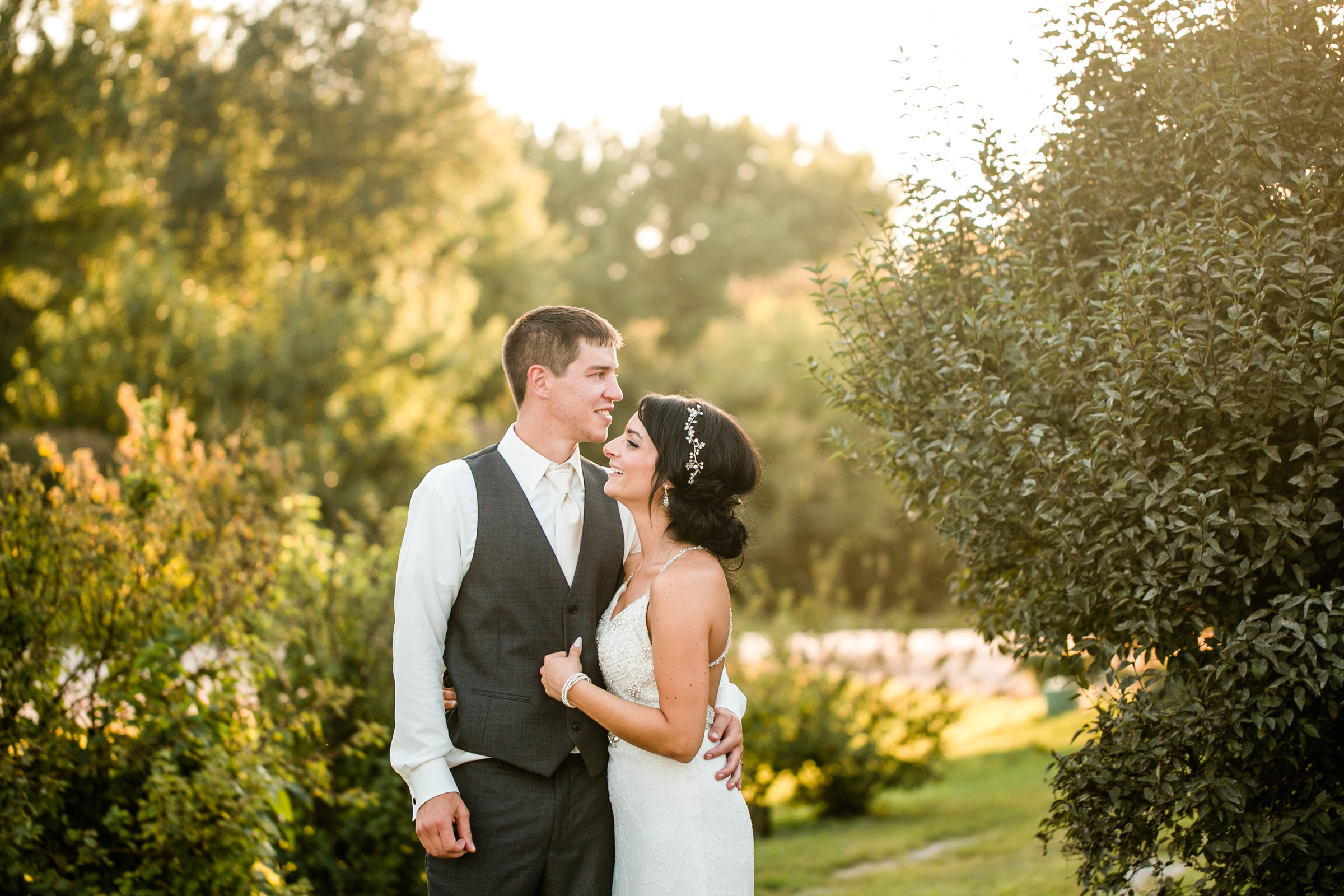 winery golden hour photos of bride and groom laughing