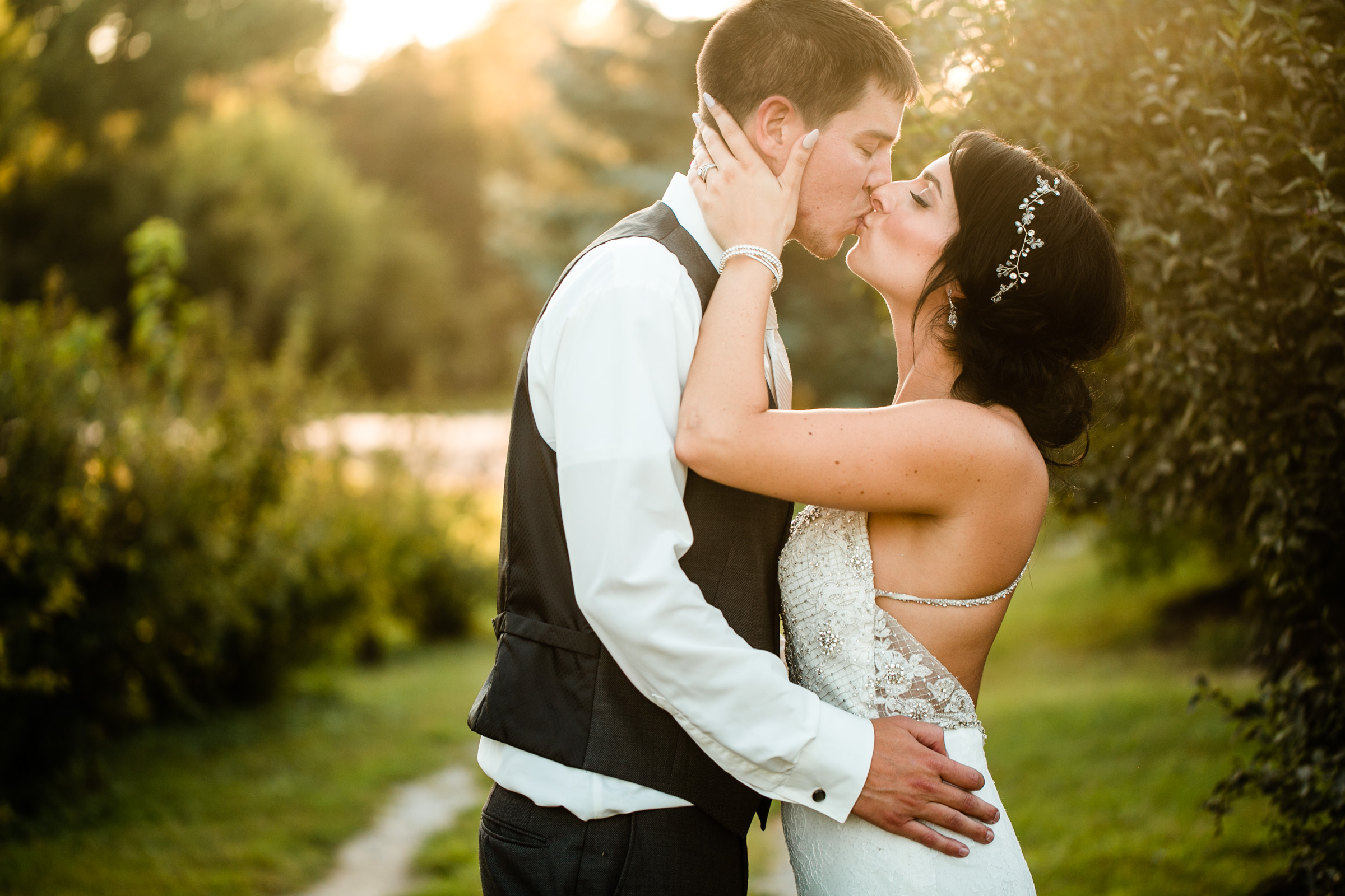 bride and groom kissing at sunset des moines wedding photographers