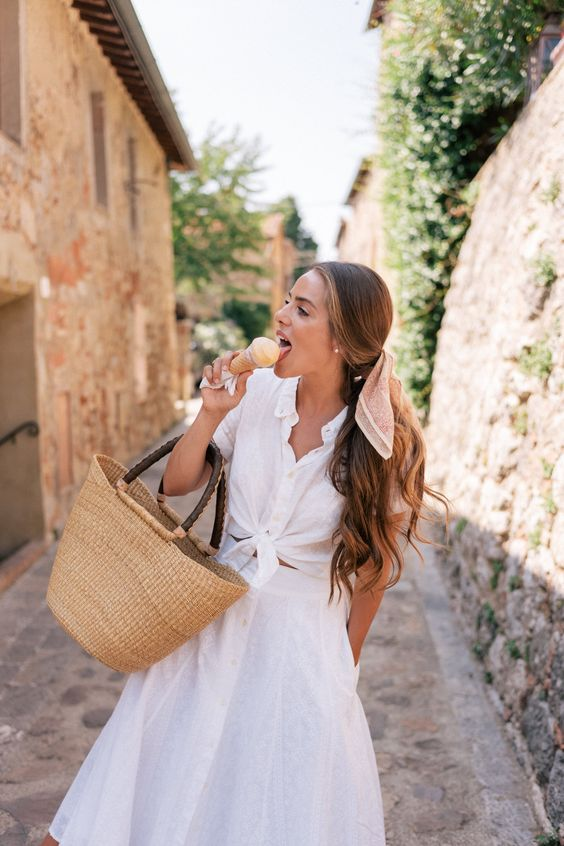 licking ice cream in white dress with bike basket in Paris