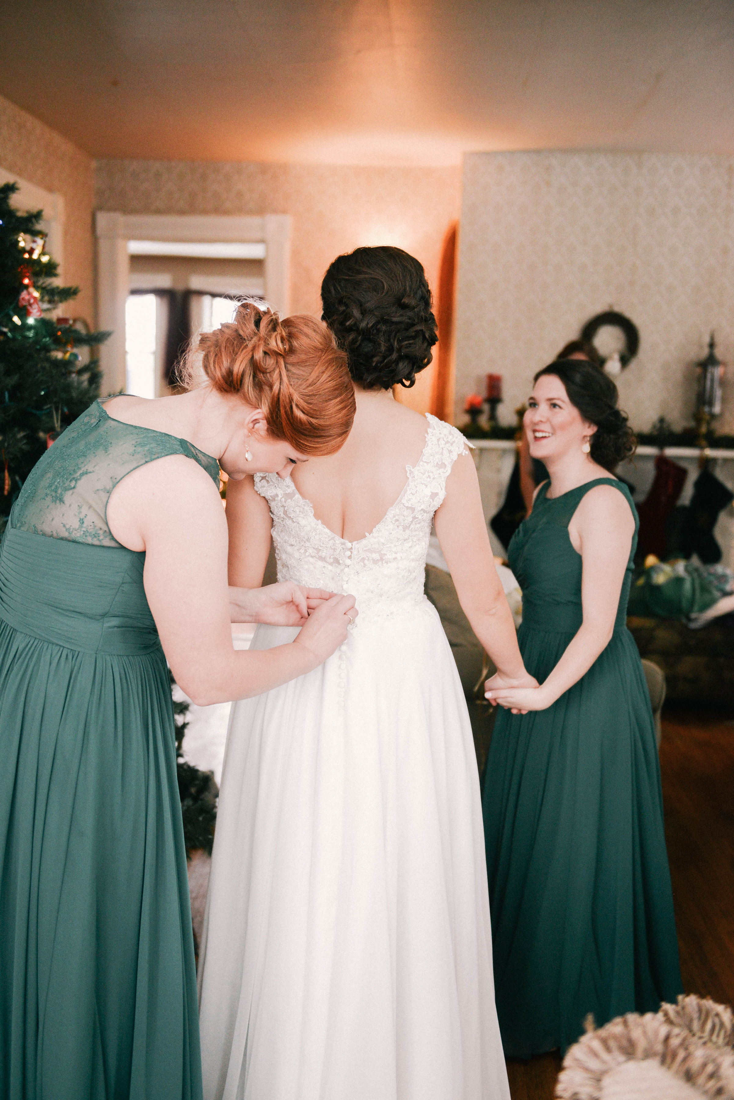 bride and bridesmaids getting ready in her home in cedar falls iowa during a winter wedding