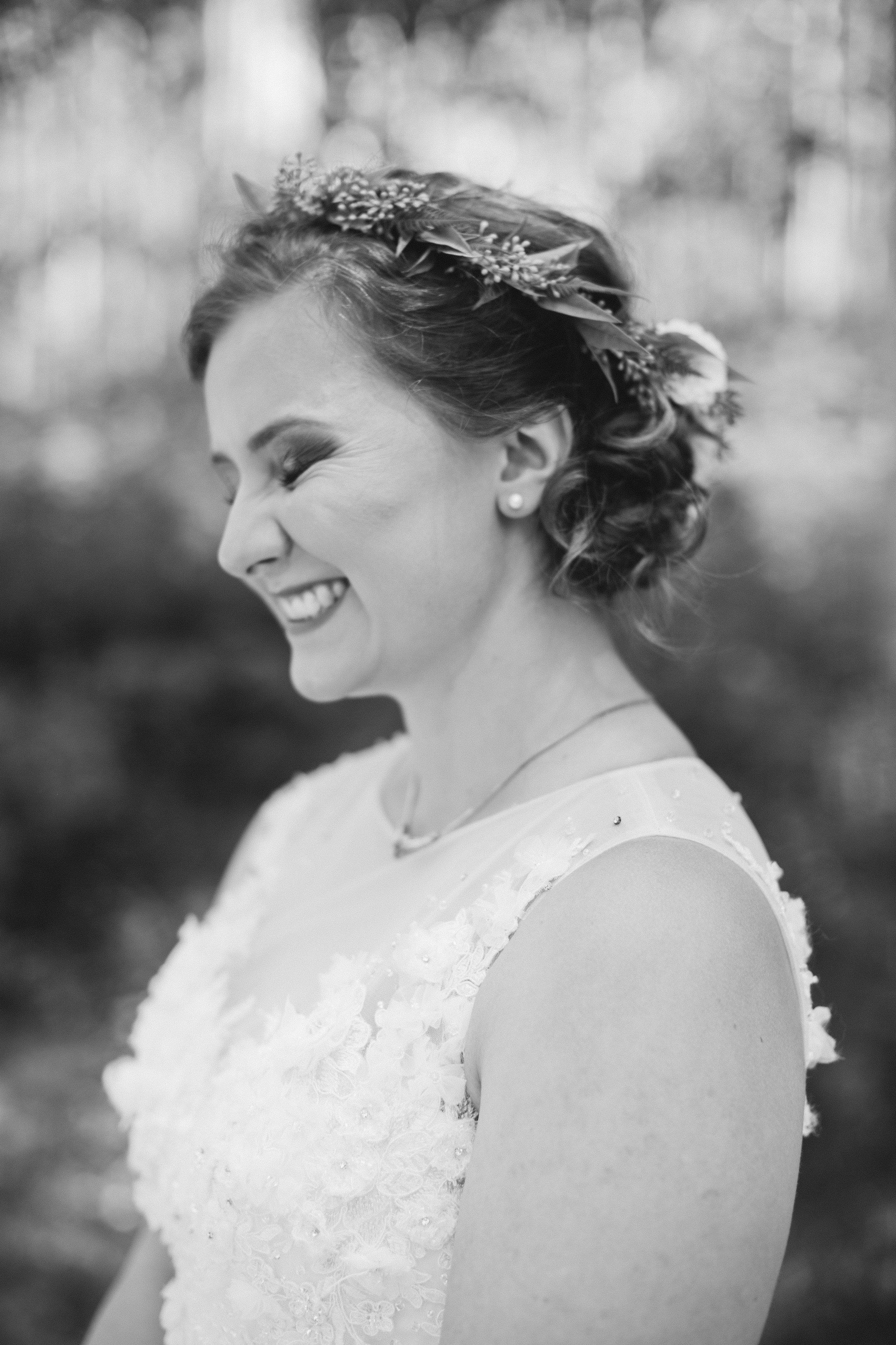 bride with flowers in her hair wedding in vail colorado mountains