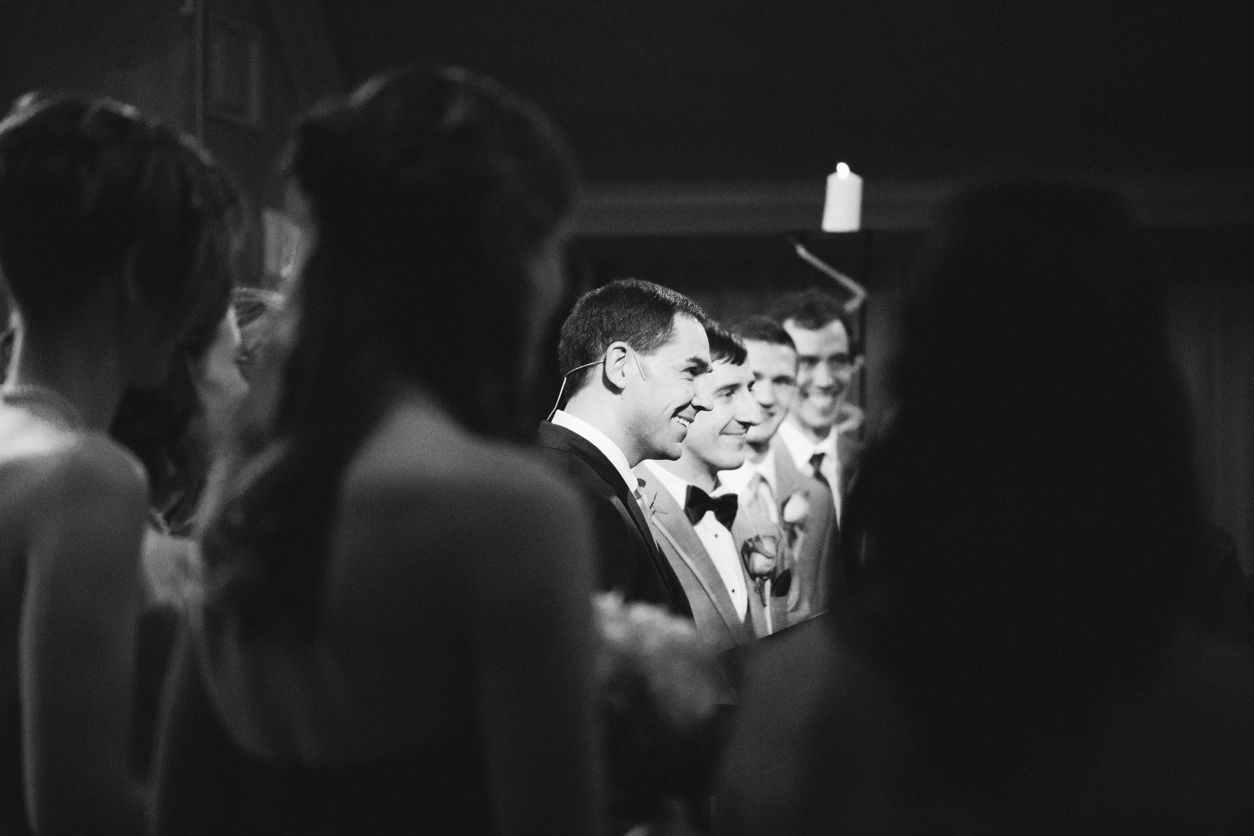groom smiling as his bride walks down the aisle ames iowa weddings