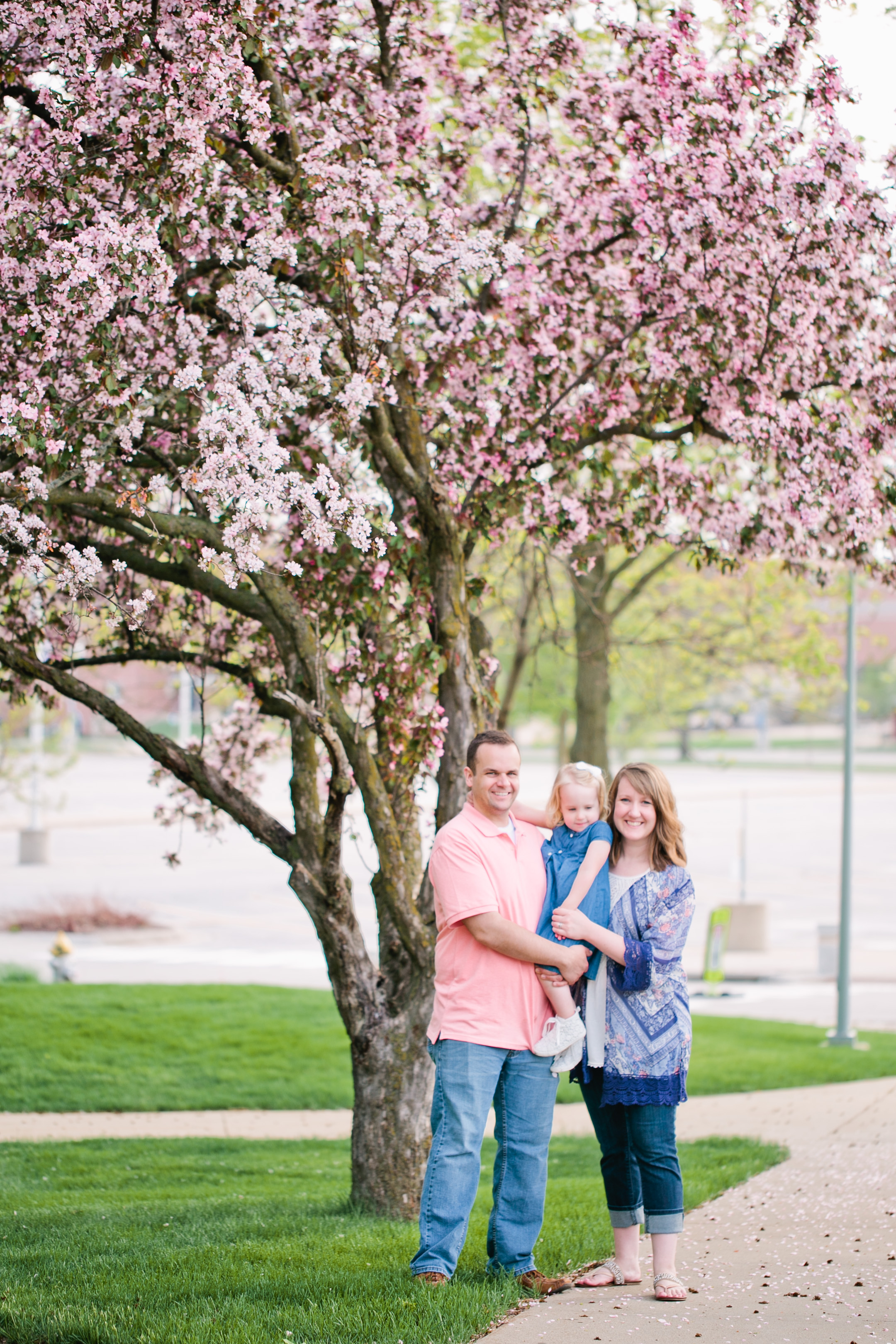 family standing under flowering tree cedar falls spring photos
