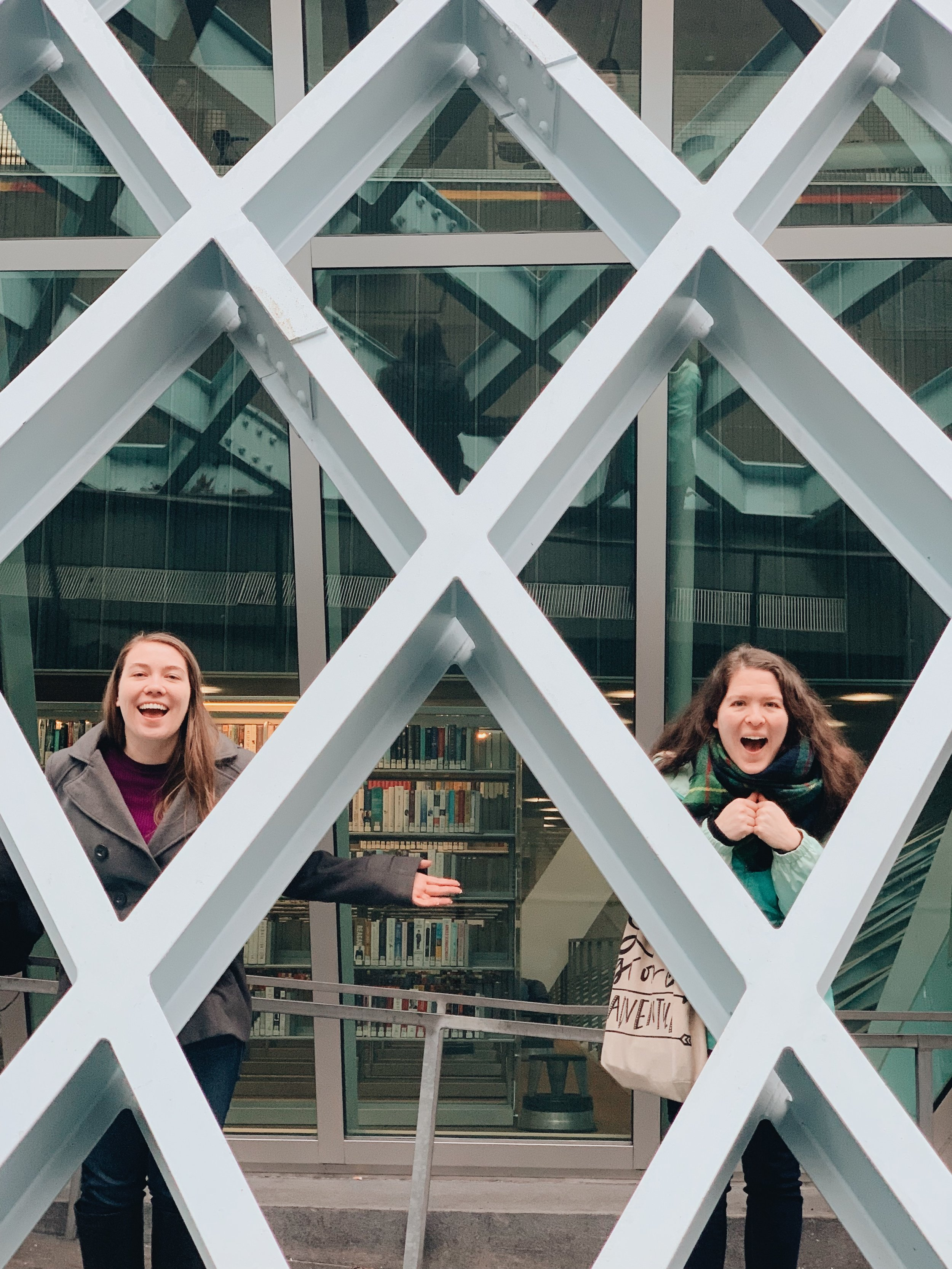 two girls traveling outside seattle library