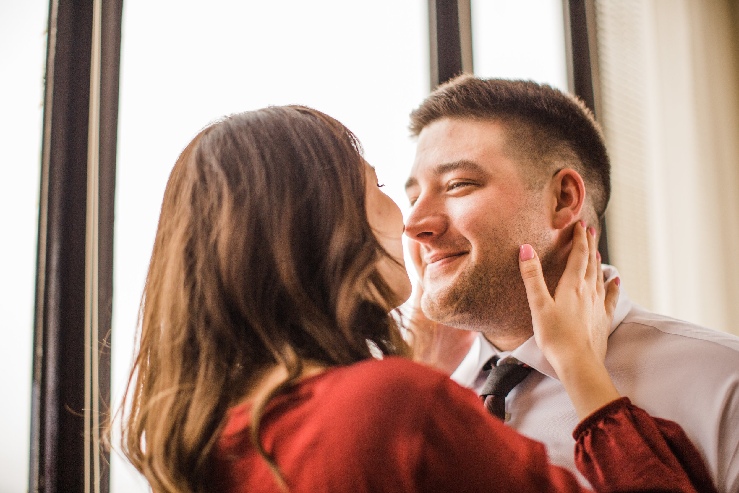 couple about to kiss valentine's day inspired engagement