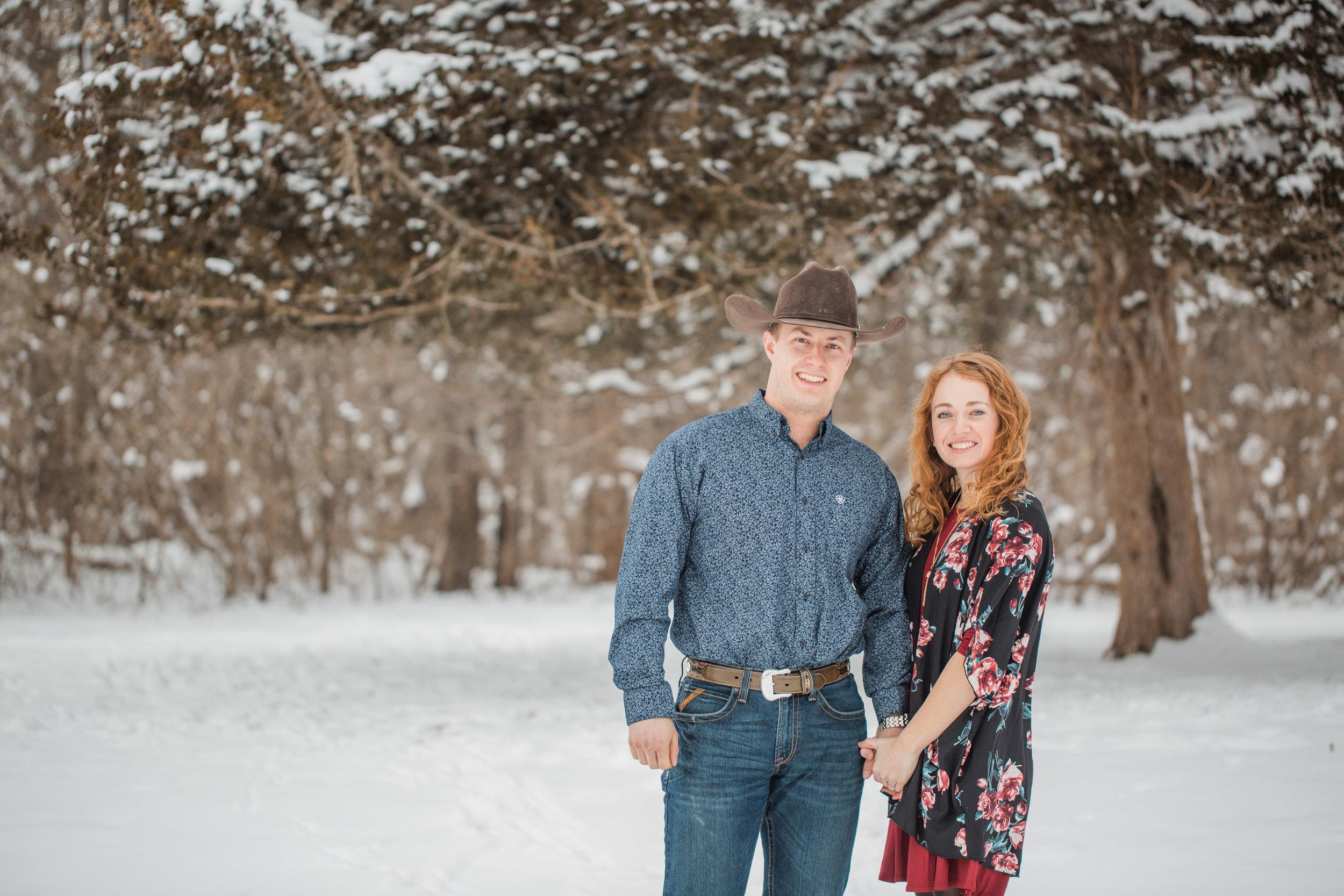 winter farm engagement photos snow des moines iowa Ames