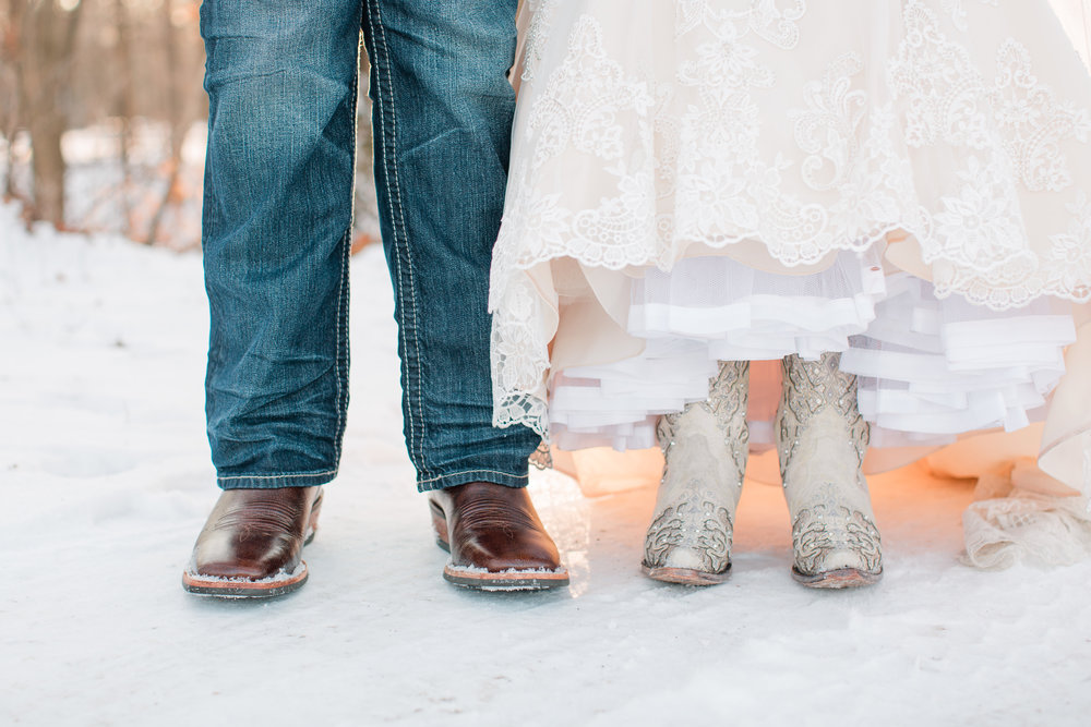 bride and groom wearing cowboy boots on country  winter wedding day  amelia renee phtoography