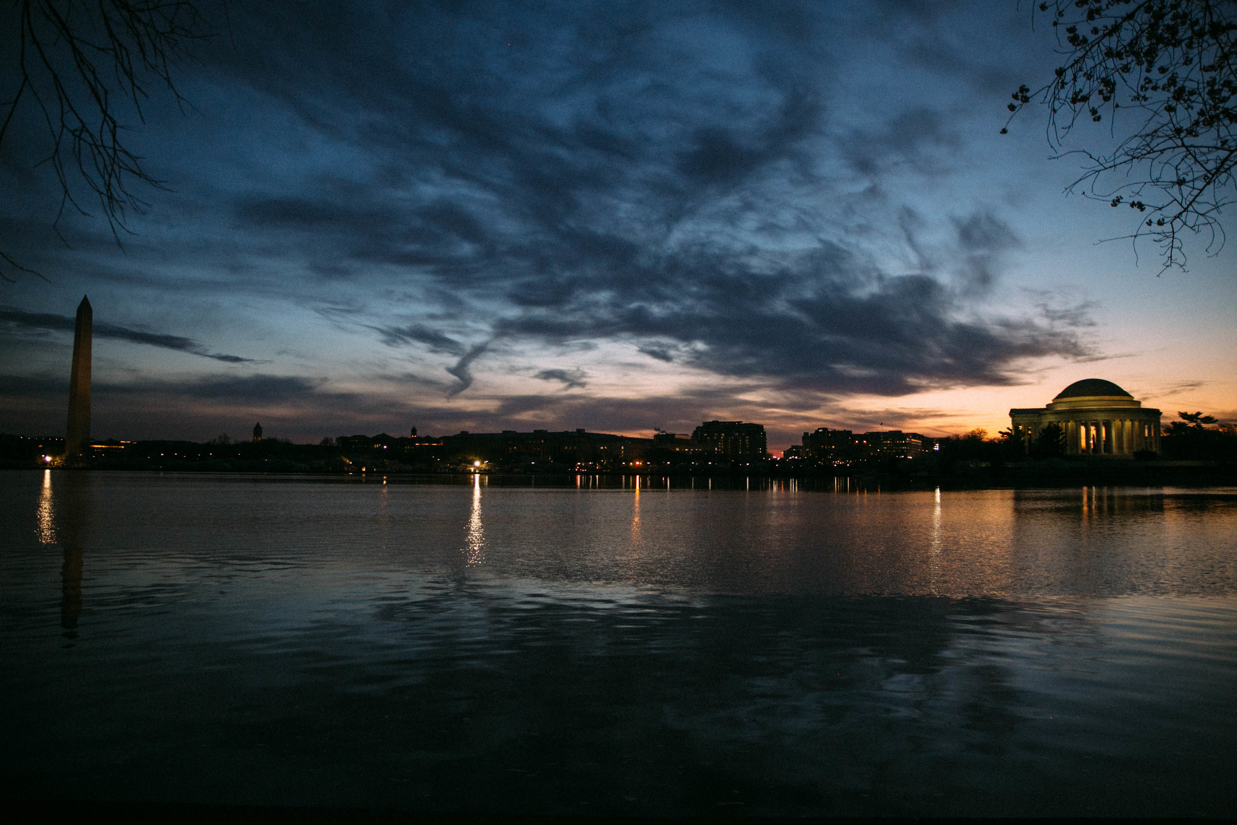 sunrise over the washington monument and jefferson memorial during cherry blossom festival
