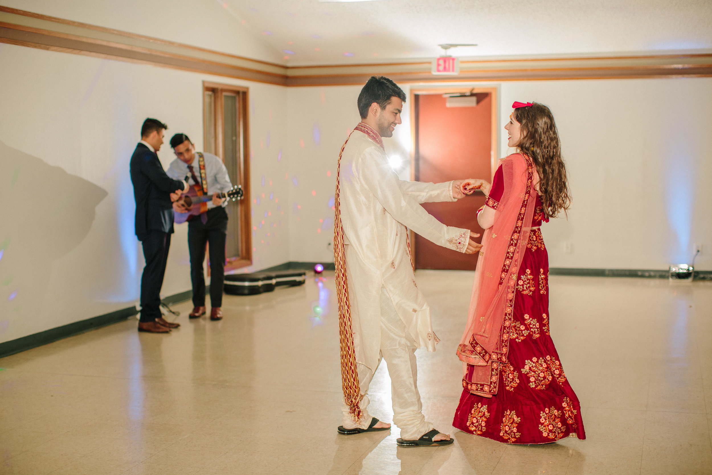Indian dancing at wedding reception photos in Des Moines Iowa