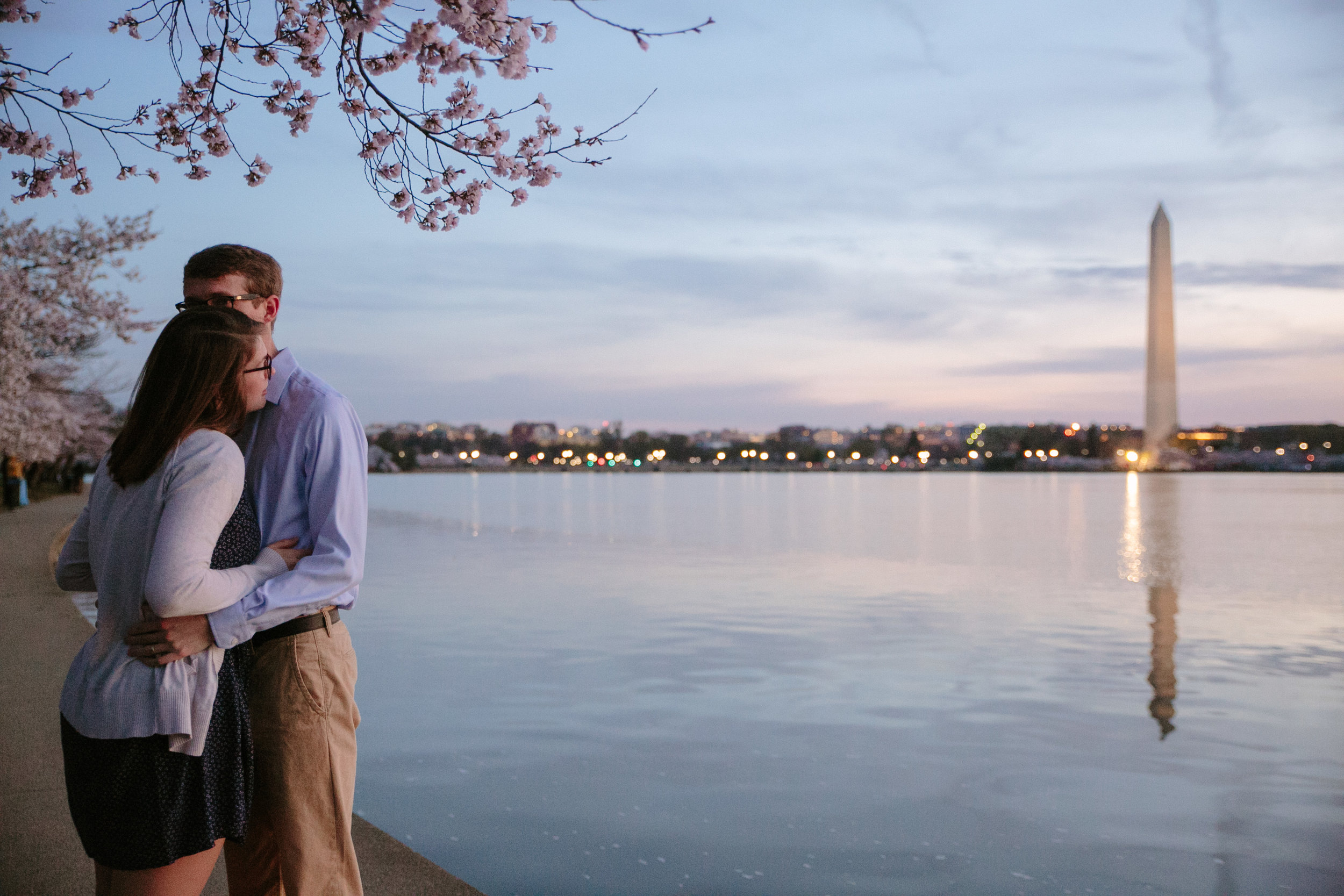 sunrise engagement photos at tidal basin during peak bloom cherry blossoms