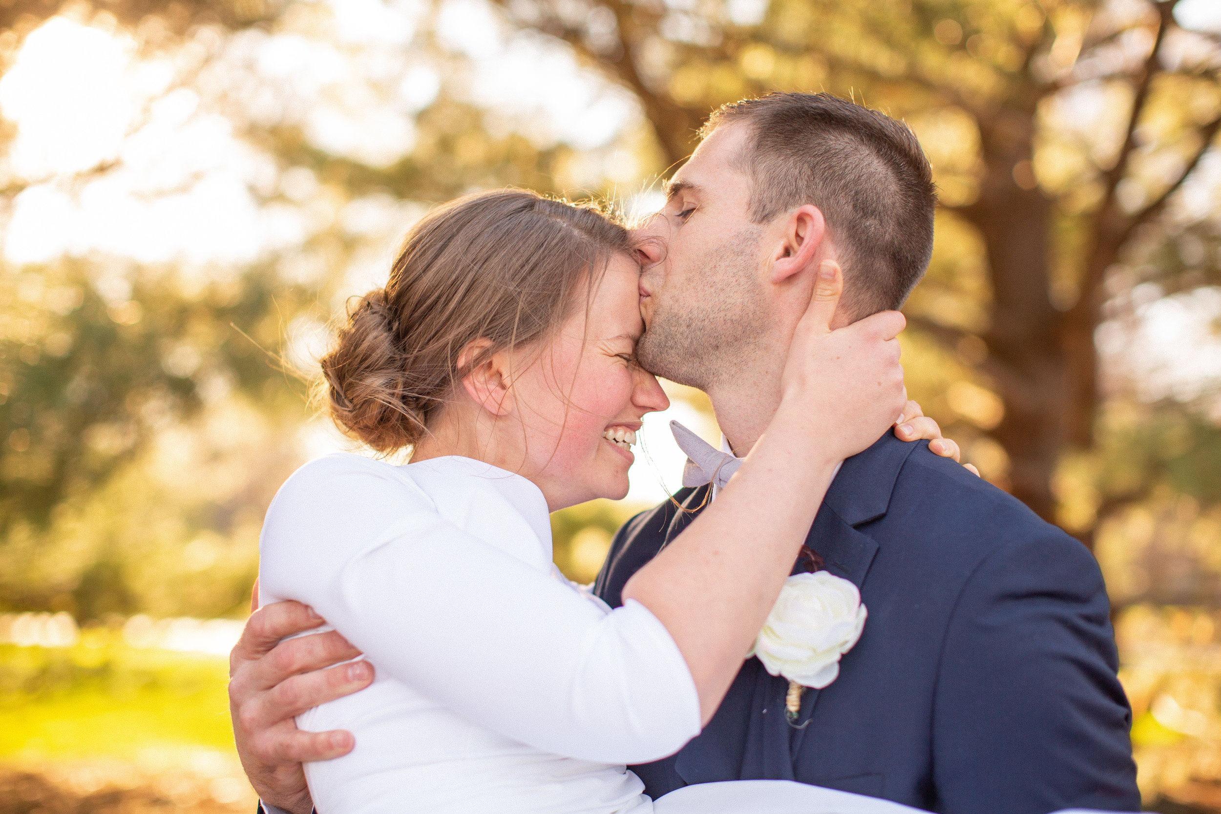 cute kissing couple wedding bride and groom des moines iowa wedding photography