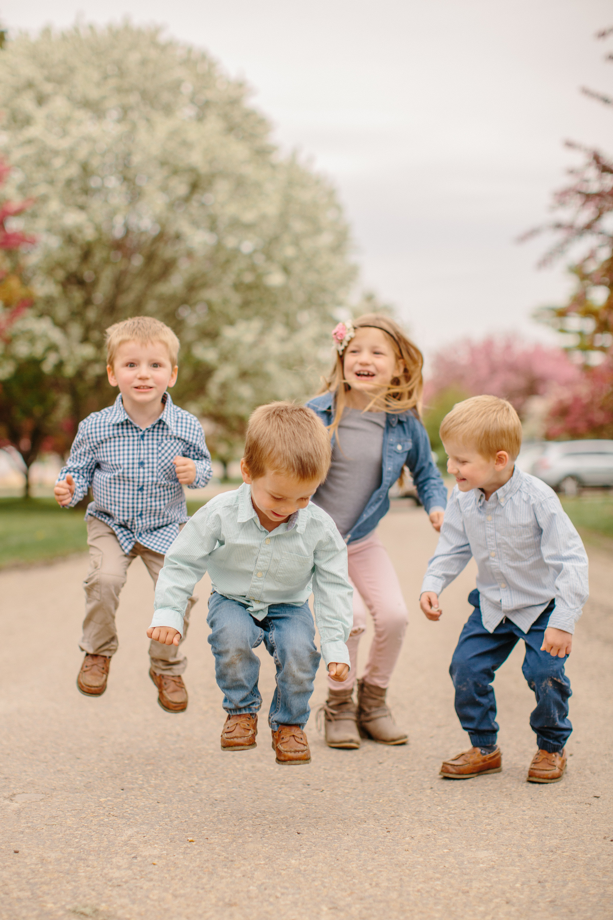 kids jumping for family photos in Des Moines Iowa