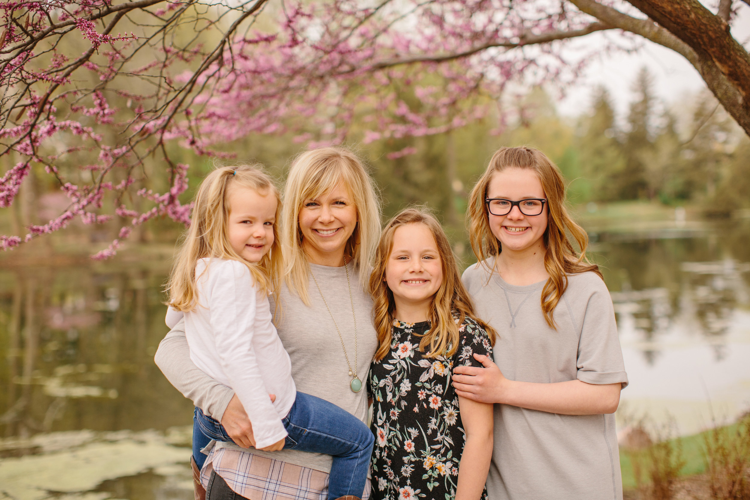 spring family photos with flowering trees Des Moines area photographers