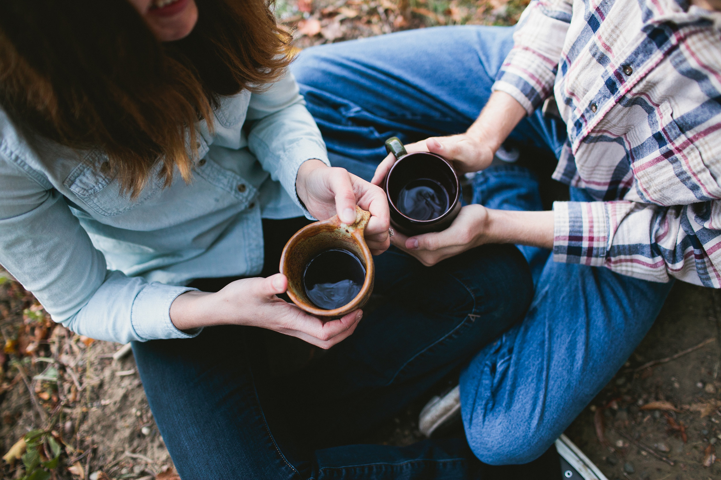 coffee and camping inspired engagement photo des moines iowa