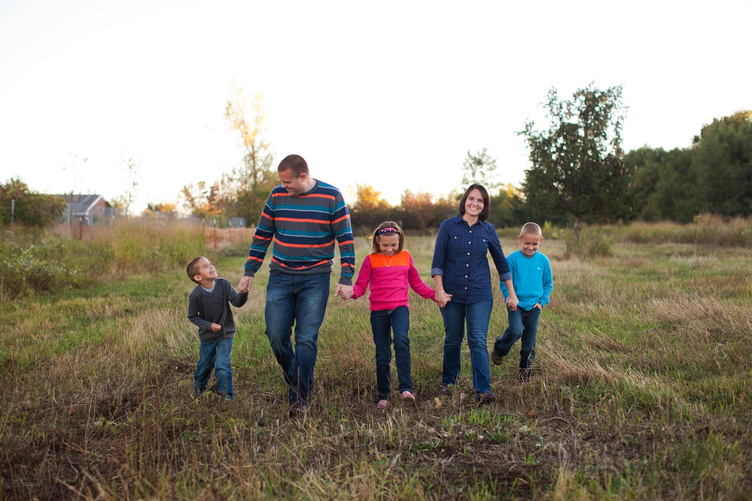 family walking at sunset holding hands cedar falls iowa family photographers