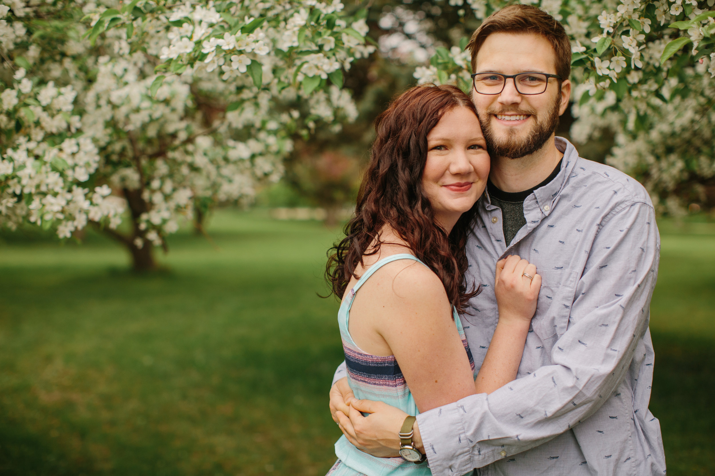 couple smiling and hugging wedding photographers in des moines iowa