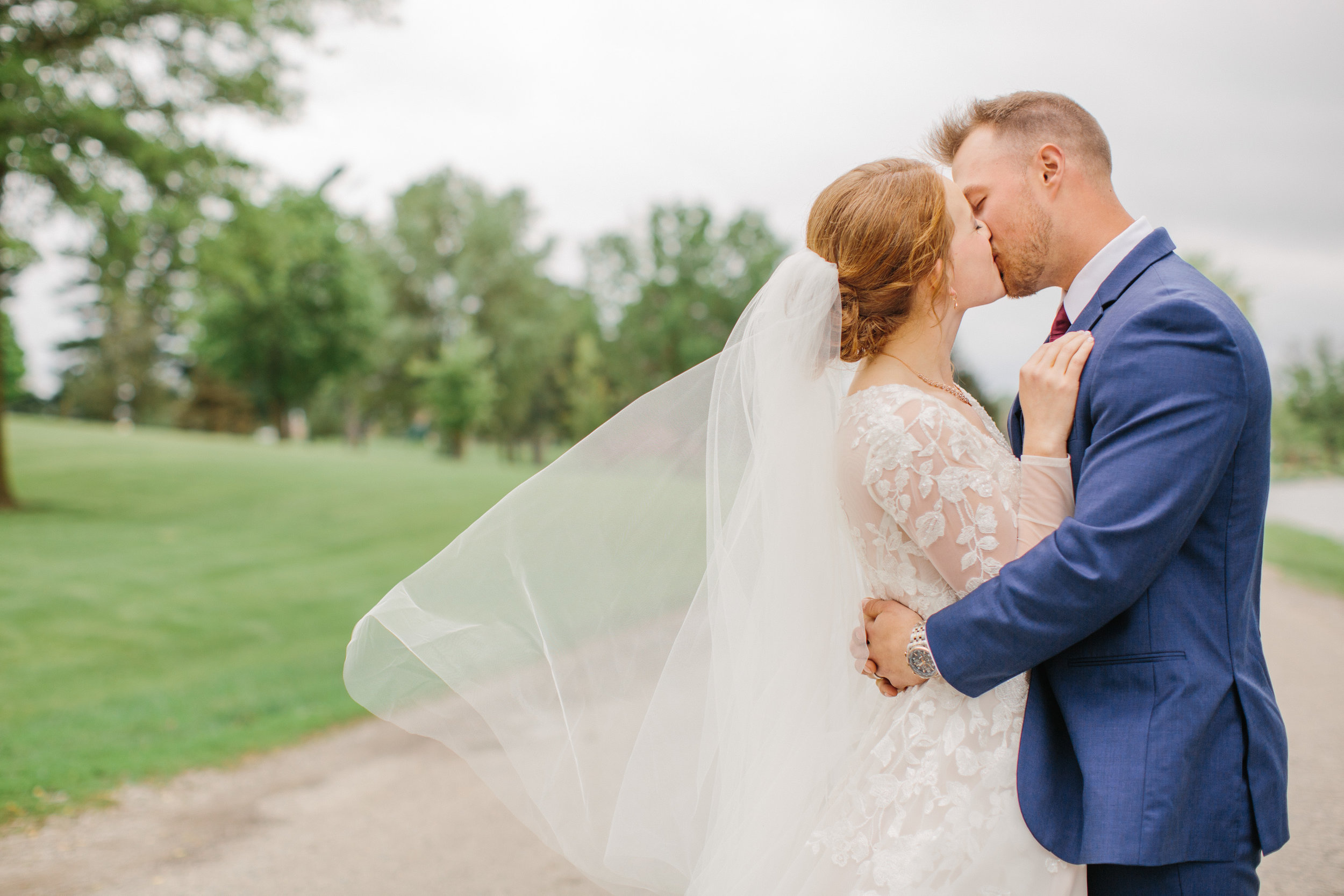 wedding photos with veil blowing in the wind