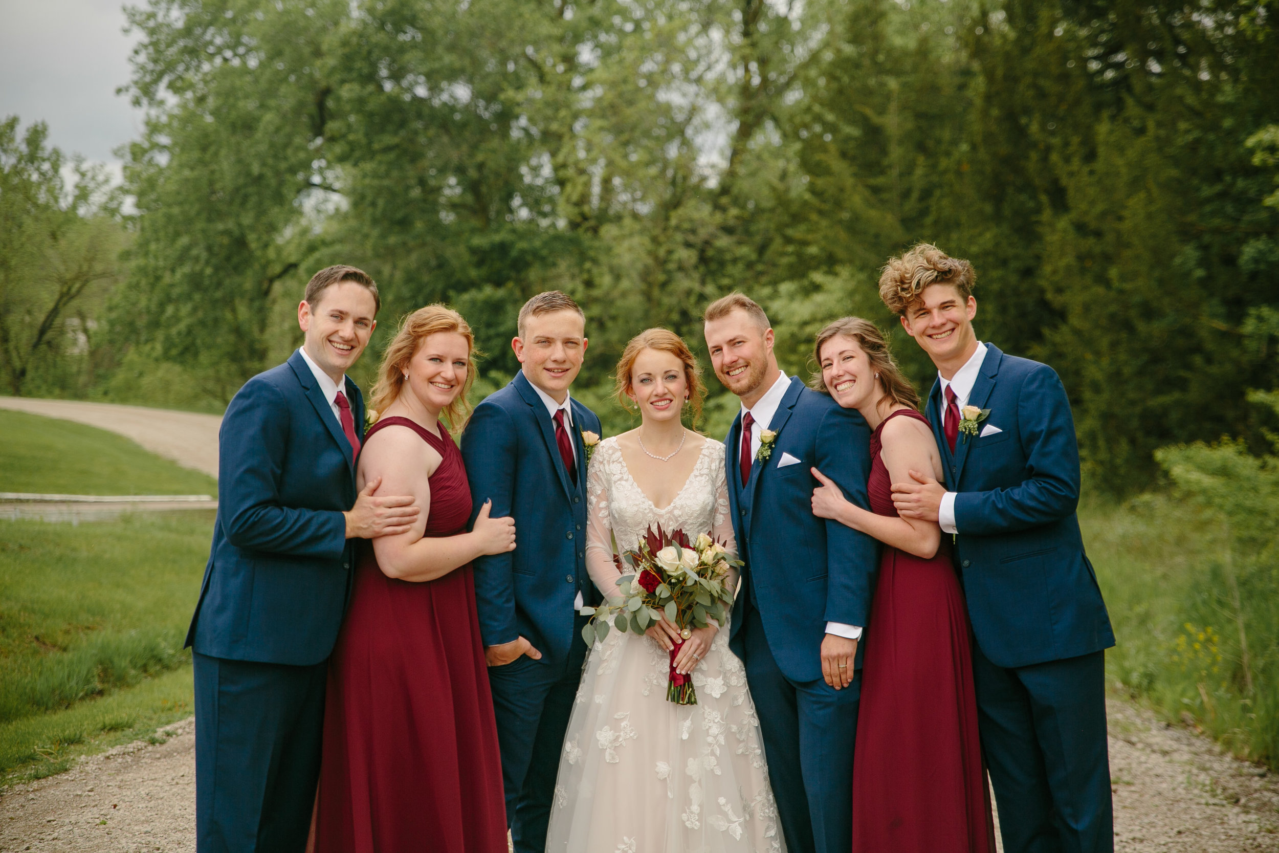 sibling family photos at outdoor wedding